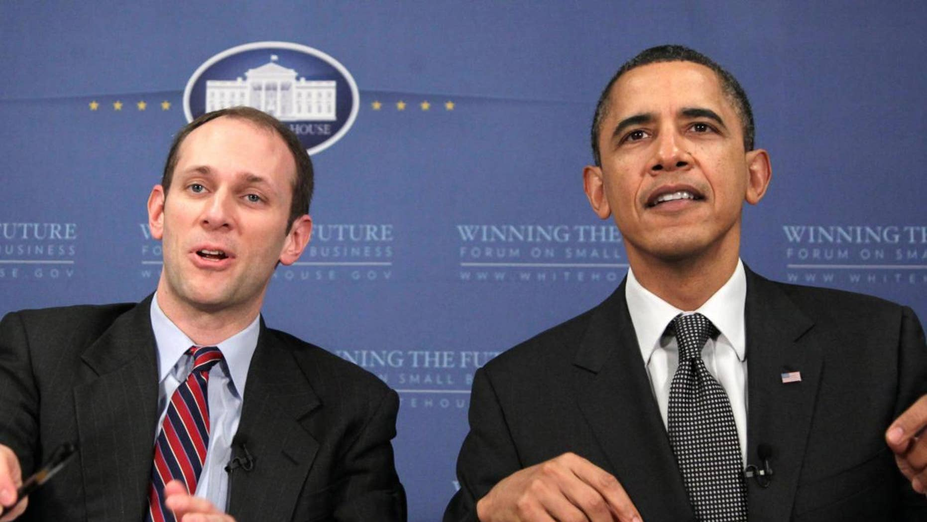 President Barack Obama and Council of Economic Advisers Chairman Austan Goolsbee, participate in an online chat session during the Winning the Future Forum on Small Business at Cleveland State University in Cleveland, Tuesday, Feb. 22, 2011. (AP Photo/Carolyn Kaster)
