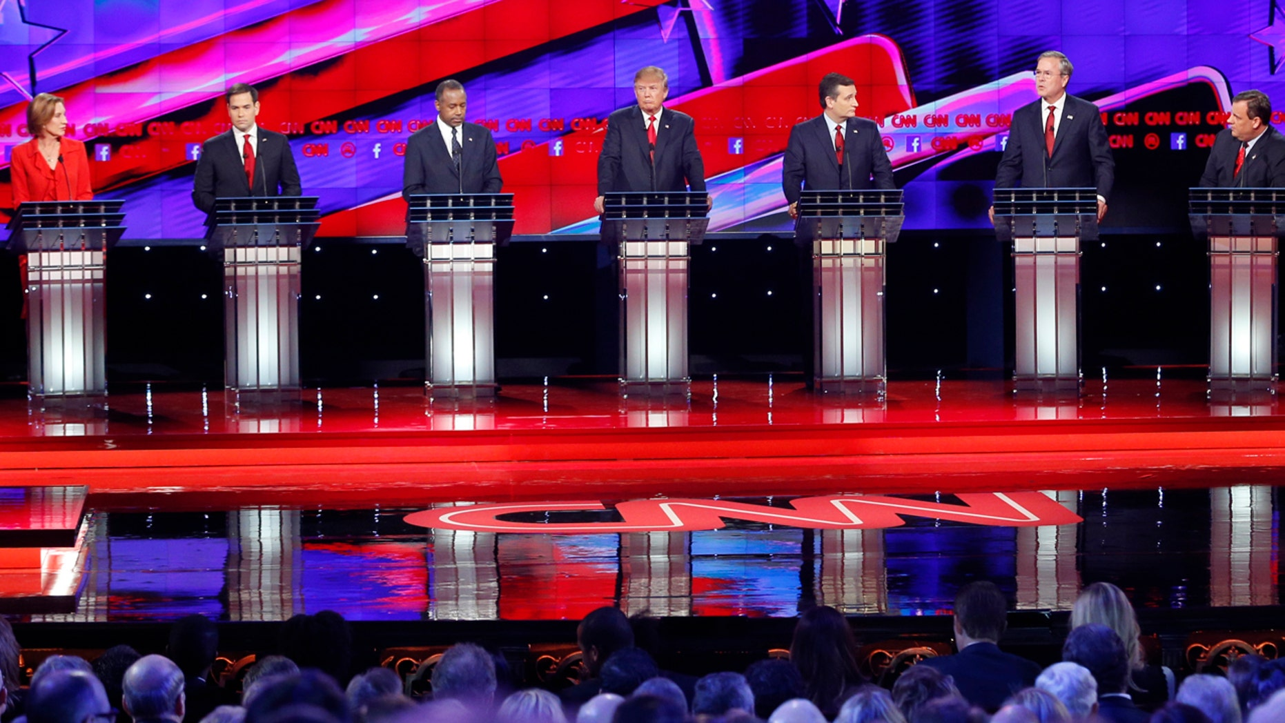 Republican presidential candidates, from left, John Kasich, Carly Fiorina, Marco Rubio, Ben Carson, Donald Trump, Ted Cruz, Jeb Bush, Chris Christie, and Rand Paul respond to debate moderator Wolf Blitzer, far left, during the CNN Republican presidential debate at the Venetian Hotel & Casino on Tuesday, Dec. 15, 2015, in Las Vegas. (AP Photo/John Locher)
