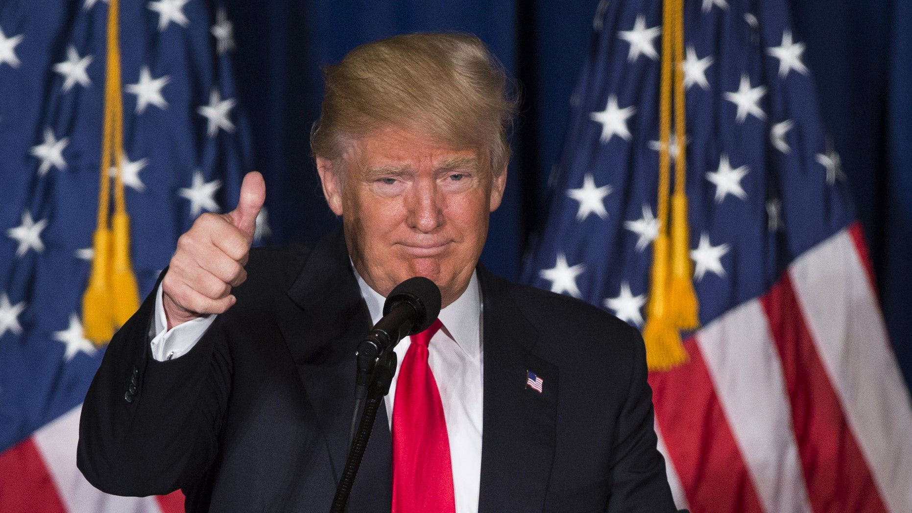 FILE -- April 27, 2016: Republican presidential candidate Donald Trump gives a thumbs up after giving a foreign policy speech at the Mayflower Hotel in Washington. (AP Photo/Evan Vucci)