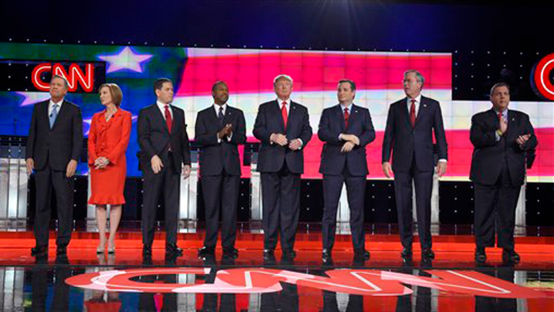 Republican presidential candidates, from left, John Kasich, Carly Fiorina, Marco Rubio, Ben Carson, Donald Trump, Ted Cruz, Jeb Bush, Chris Christie, and Rand Paul take the stage during the CNN Republican presidential debate at the Venetian Hotel & Casino on Tuesday, Dec. 15, 2015, in Las Vegas. (AP Photo/Mark J. Terrill)