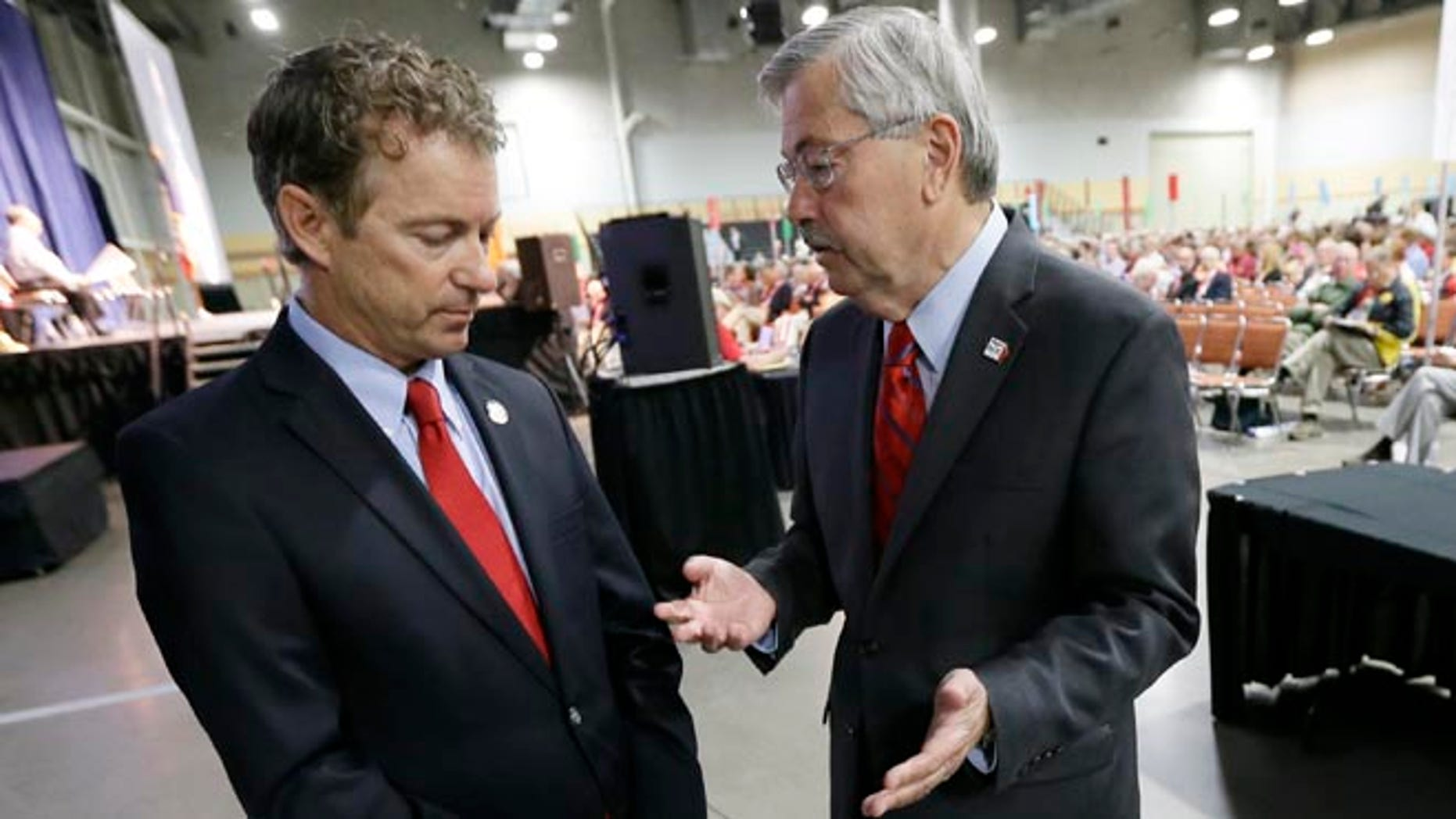 June 14, 2014: Iowa Gov. Terry Branstad, right, talks with Sen. Rand Paul, R-Ky., during the Iowa State Republican Convention in Des Moines, Iowa.