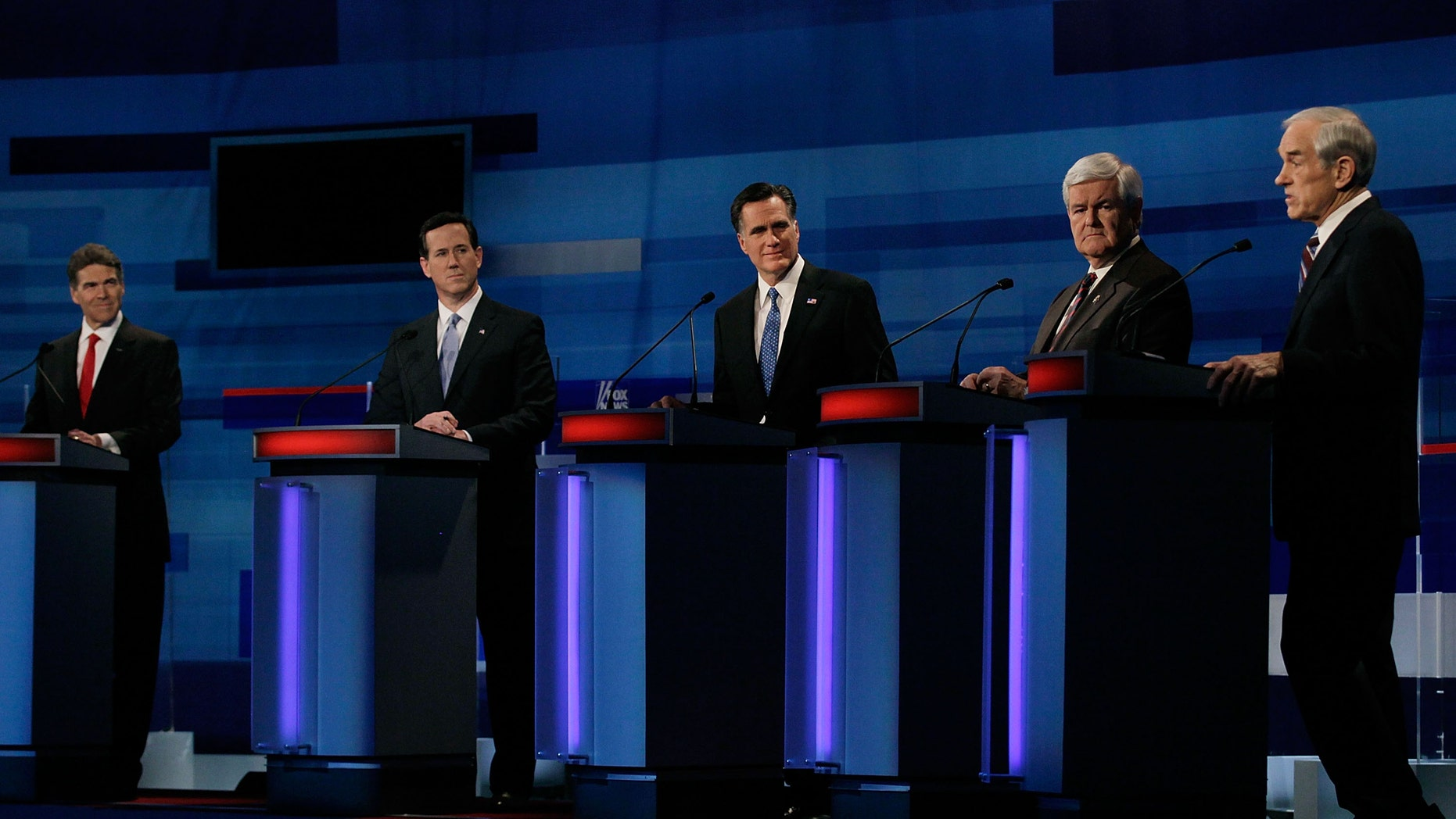 MYRTLE BEACH, SC - JANUARY 16: Republican presidential candidates (L-R) Texas Gov. Rick Perry, former U.S. Sen. Rick Santorum (R-PA), former Massachusetts Gov. Mitt Romney, former U.S. House Speaker Newt Gingrich (R-GA) and U.S. Rep. Ron Paul (R-TX) participate in a Fox News, Wall Street Journal-sponsored debate at the Myrtle Beach Convention Center, on January 16, 2012 in Myrtle Beach, South Carolina. Voters in South Carolina will head to the polls on January 21st. to vote in the Republican primary election to pick their choice for U.S. presidential candidate. (Photo by Joe Raedle/Getty Images)