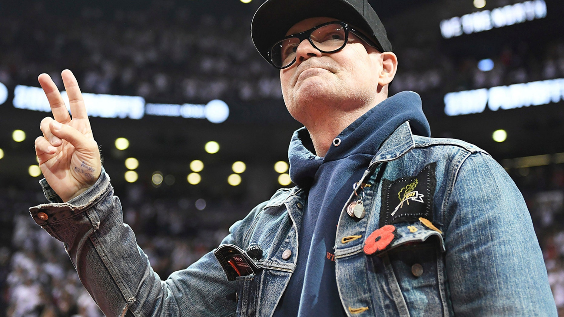 In this May 5, 2017 file photo, lead singer of The Tragically Hip Gord Downie salutes fans during the first half of Game 3 of an NBA basketball second-round playoff series between the Toronto Raptors and the Cleveland Cavaliers in Toronto. The widely revered lead singer died Tuesday night, Oct. 17, 2017.