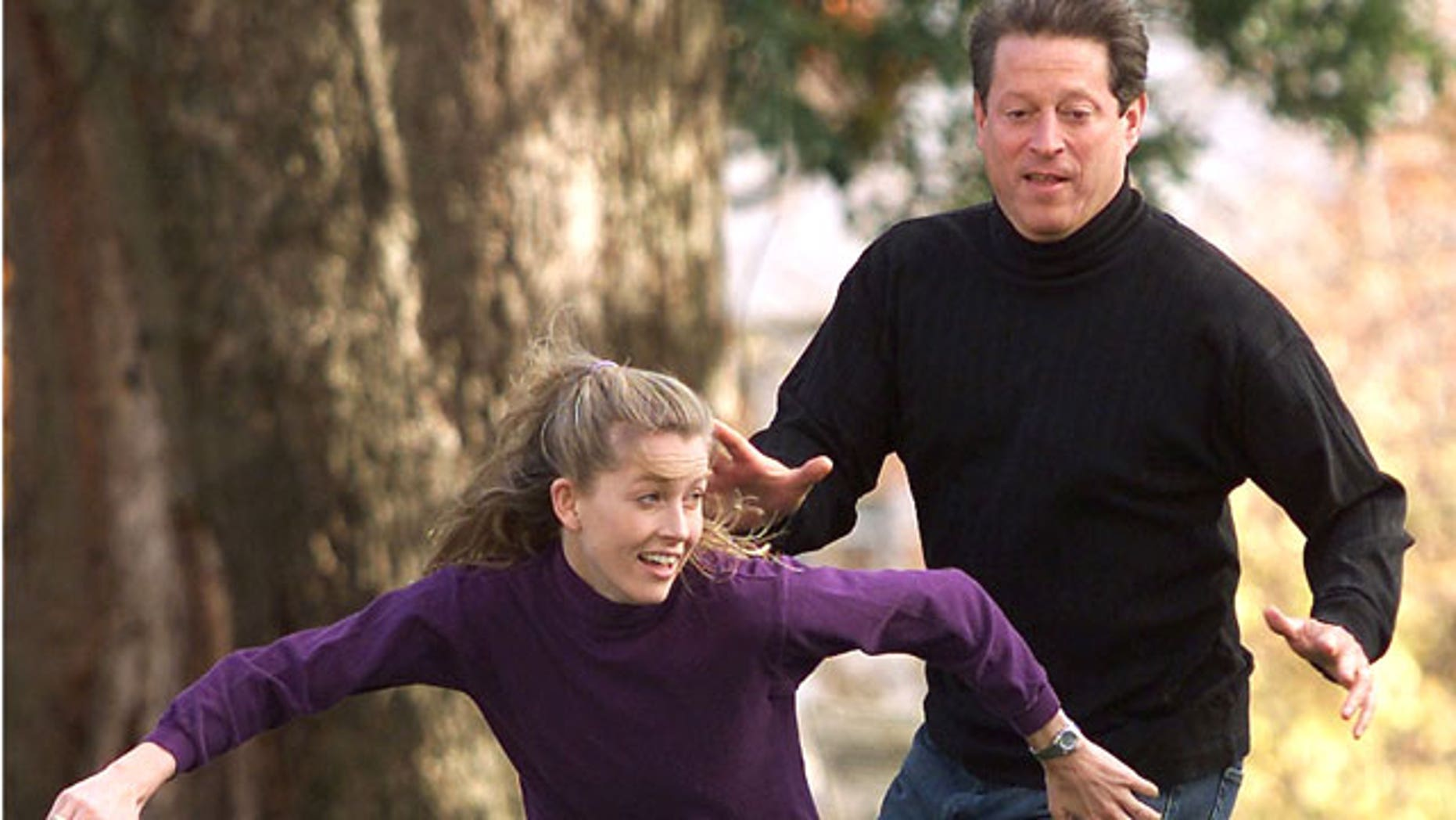 Vice President Al Gore covers his daughter Karenna on a pass play during a touch football game with his family, November 10, 2000 outside the Vice Presidential residence in Washington. (Reuters)
