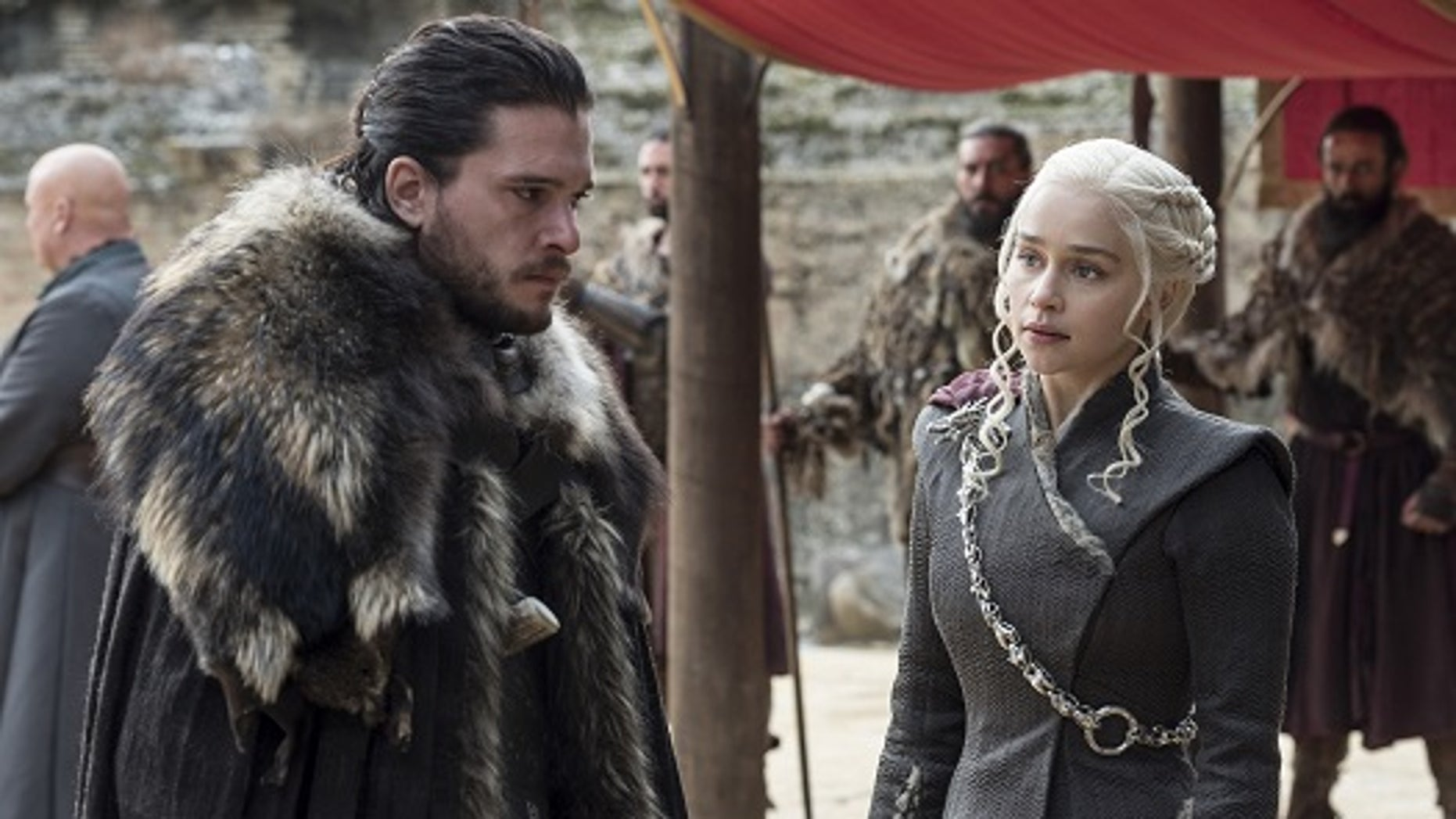 """This image released by HBO shows Kit Harington, left, and Emilia Clarke on the season finale of """"Game of Thrones."""""""