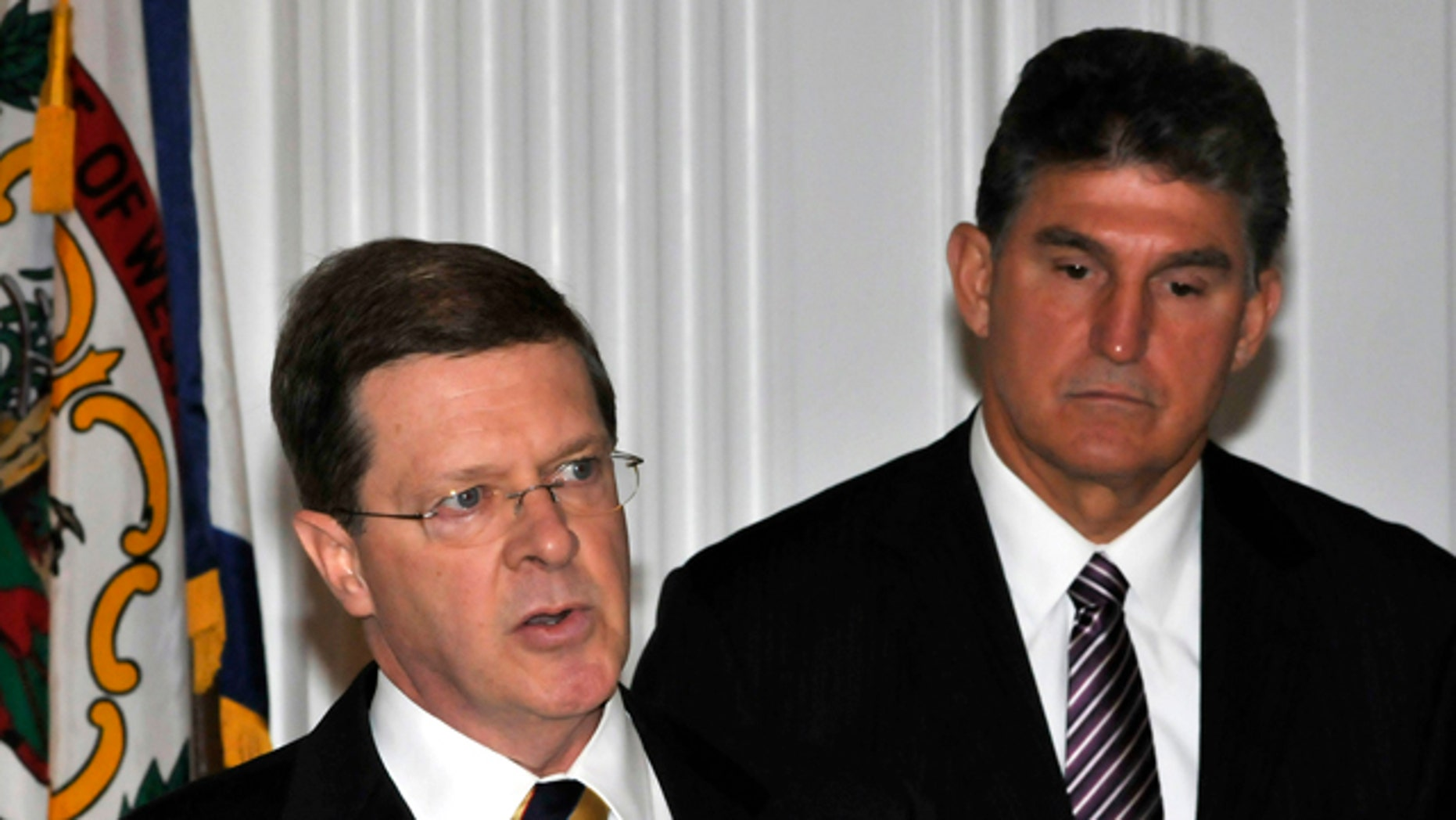Oct. 6, 2010: Ben Bailey, hired by the state of West Virginia to file a lawsuit against the Obama administration's efforts to curb mountaintop removal coal mining, speaks as W.Va. Gov. Joe Manchin, right, listens at the Capitol in Charleston, W.Va.