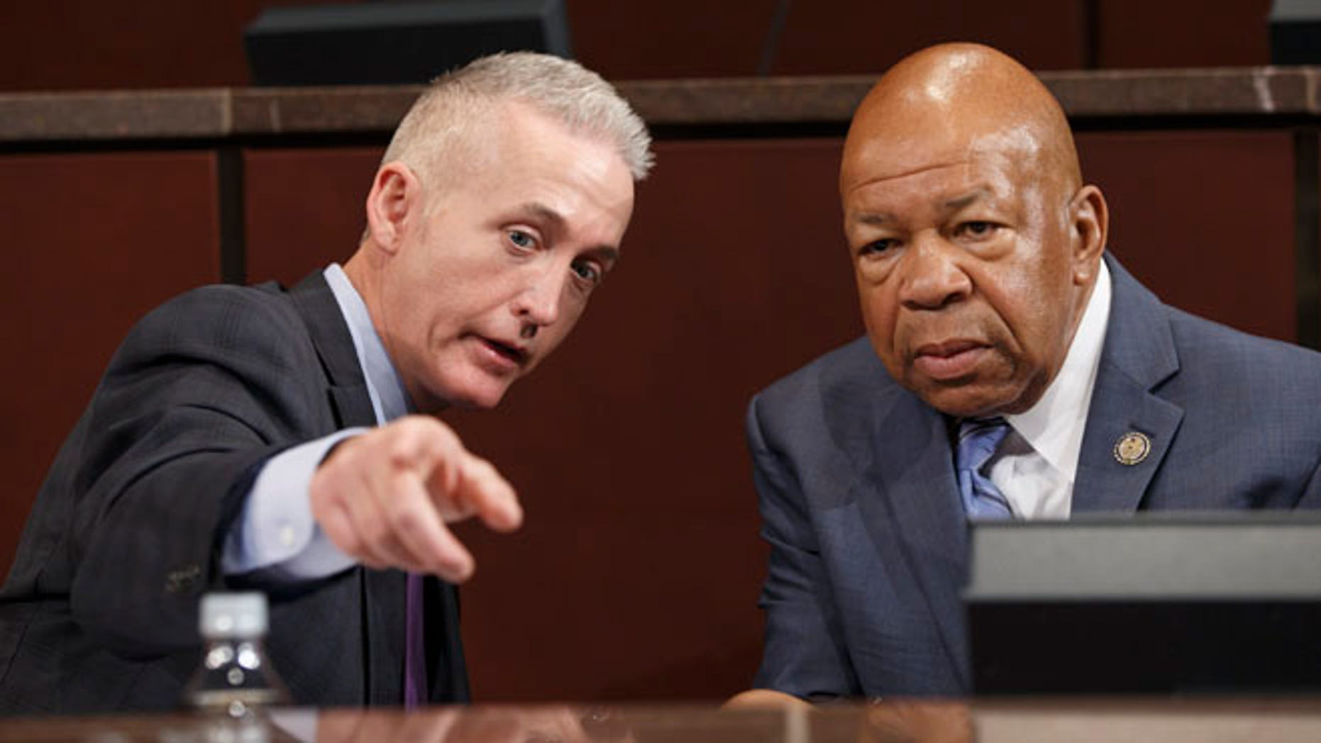 Sept. 17, 2014: Rep. Trey Gowdy, R-S.C., chairman of the House Select Committee on Benghazi, and Rep. Elijah Cummings, D-Md., right, the ranking member, confer before a hearing to investigate the 2012 attacks on the U.S. consulate in Benghazi, Libya.