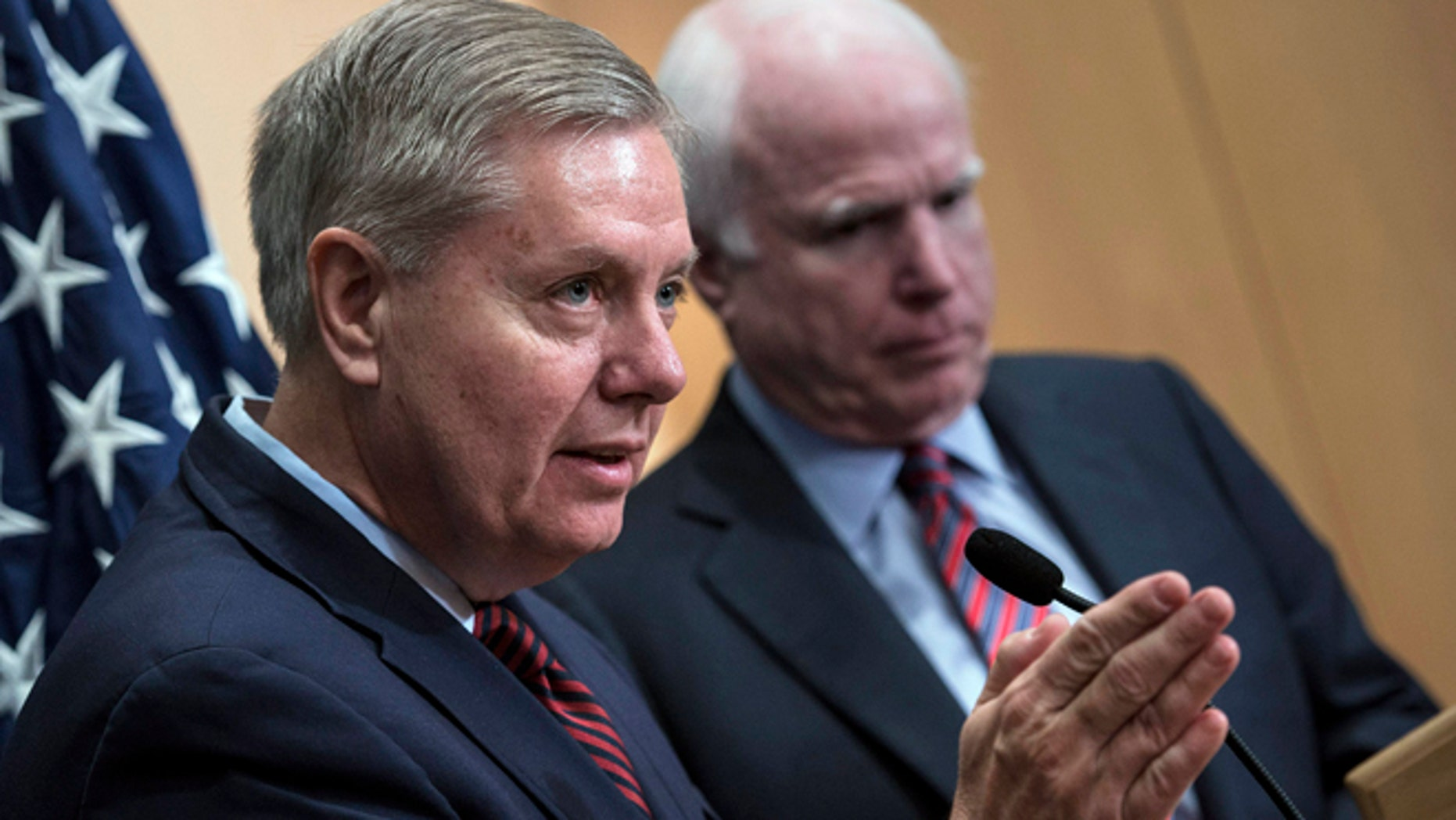 Jan. 3, 2014: Sen. Lindsey Graham, R-S.C., left, speaks near Sen. John McCain, R-Ariz., during a news conference at the David Citadel hotel in Jerusalem.