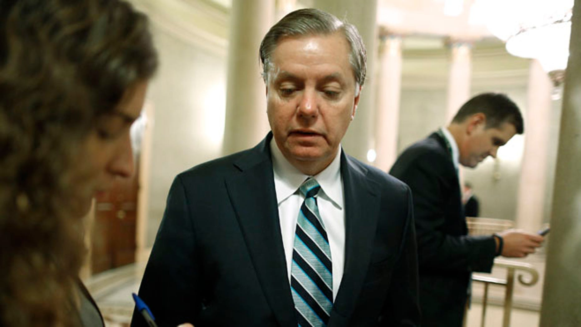 Oct. 16, 2013: Sen. Lindsey Graham, R-S.C., speaks to a reporter on Capitol Hill.