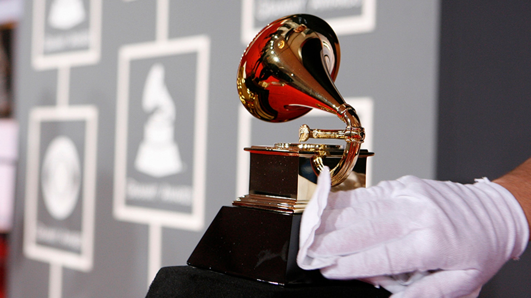 A white-gloved worker polishes a Grammy Award before the 51st annual Grammy Awards in Los Angeles February 8, 2009.