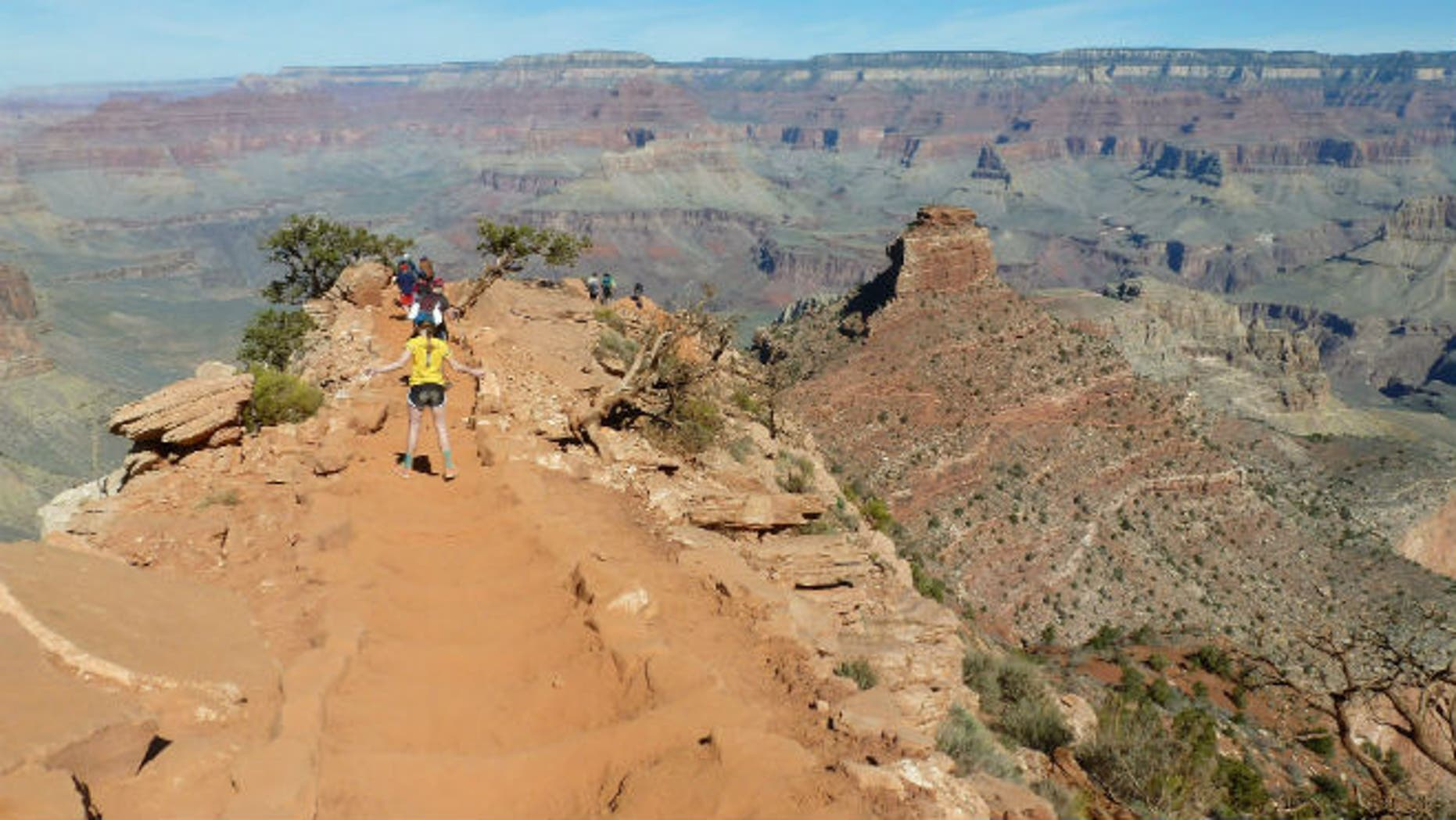 Hikers make their way along a ridgeline on the Grand Canyon National Park's South Kaibab trail on March 16, 2015. (AP Photo/Anna Johnson)