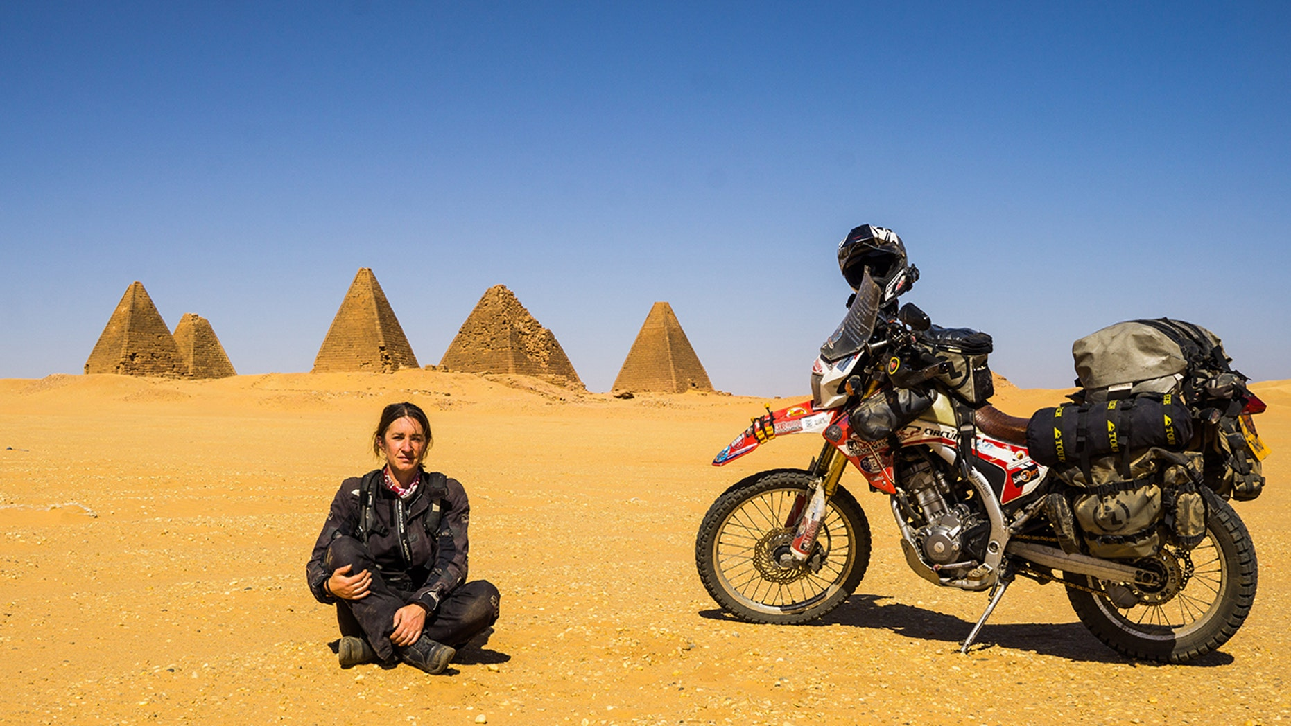 A grandmother from Wales just returned from a four-year journey around the world, all by motorbike.