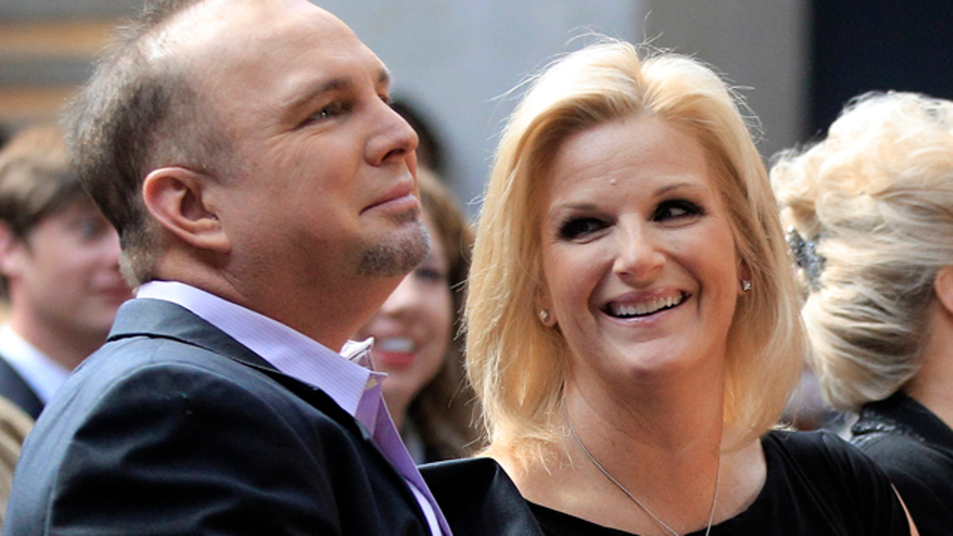 March 6: Garth Brooks and his wife Trisha Yearwood listen during the announcement that Brooks will be inducted into the Country Music Hall of Fame.