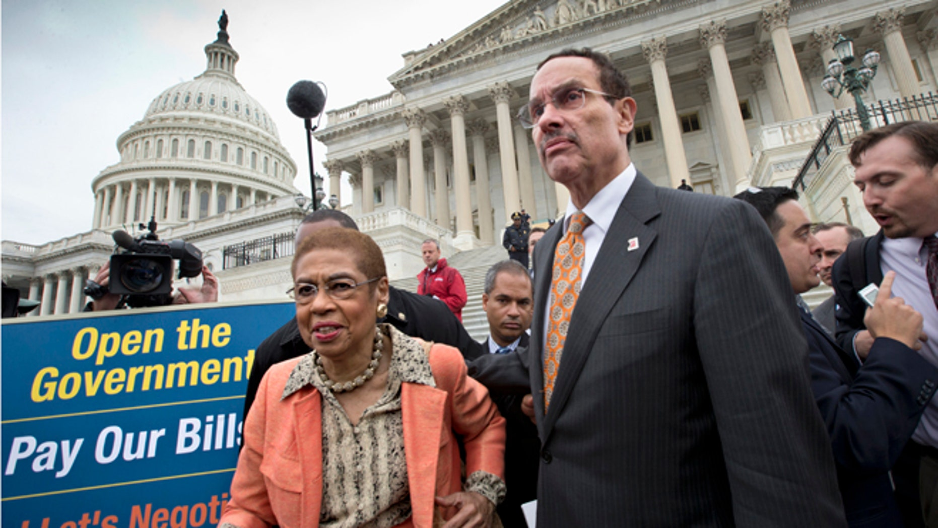 Oct. 9, 2013: Washington Mayor Vincent Gray, right, and Del. Eleanor Holmes Norton, D-D.C., left, make their way through the crowd after joining a Senate Democratic press conference in Washington.