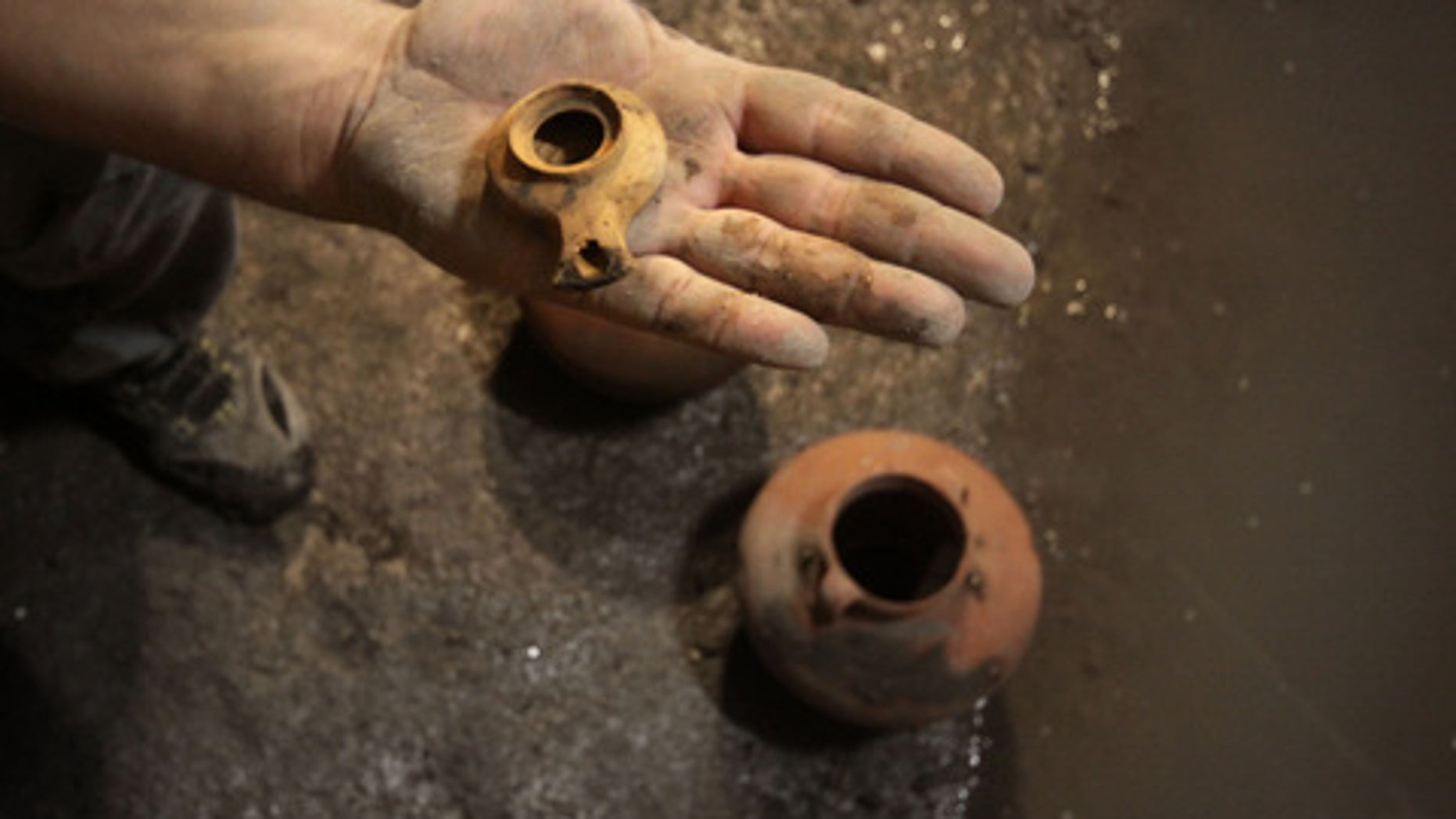 This ceramic oil lamp and two cooking pots were found in a cistern in Jerusalem and date back to the first Jewish revolt against the Romans (A.D. 66-73).