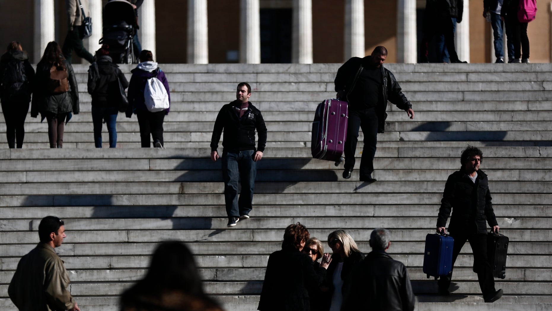 Jan. 9 ,2015: Pedestrians walk in front of the Greek parliament, in central Athens.
