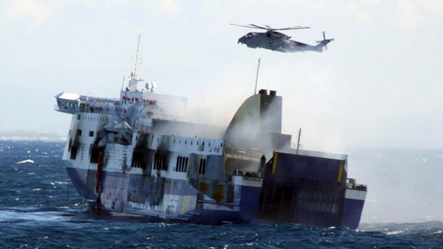 Dec. 29, 2014: In this image released by the Italian Navy, smoke billows from the Italian-flagged Norman Atlantic that caught fire in the Adriatic Sea.