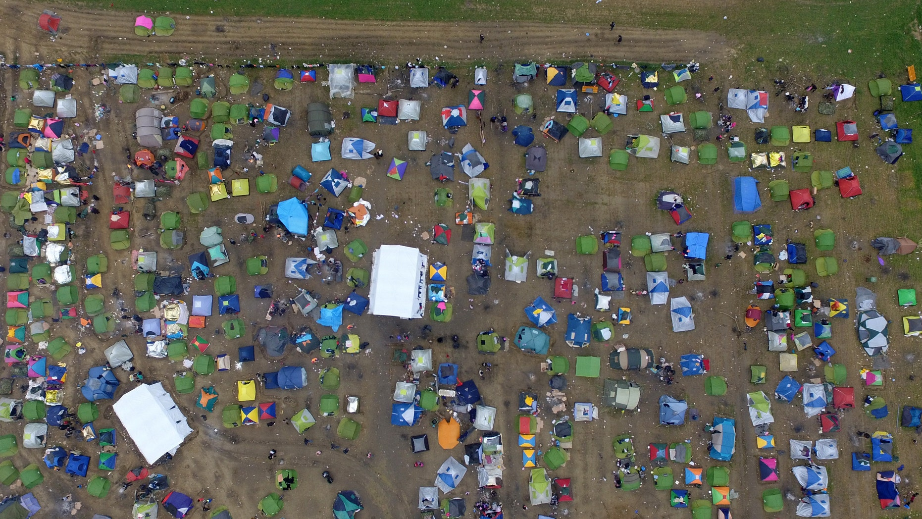 Tents of refugees and migrants stand next to a refugee camp at the Greek-Macedonian border.