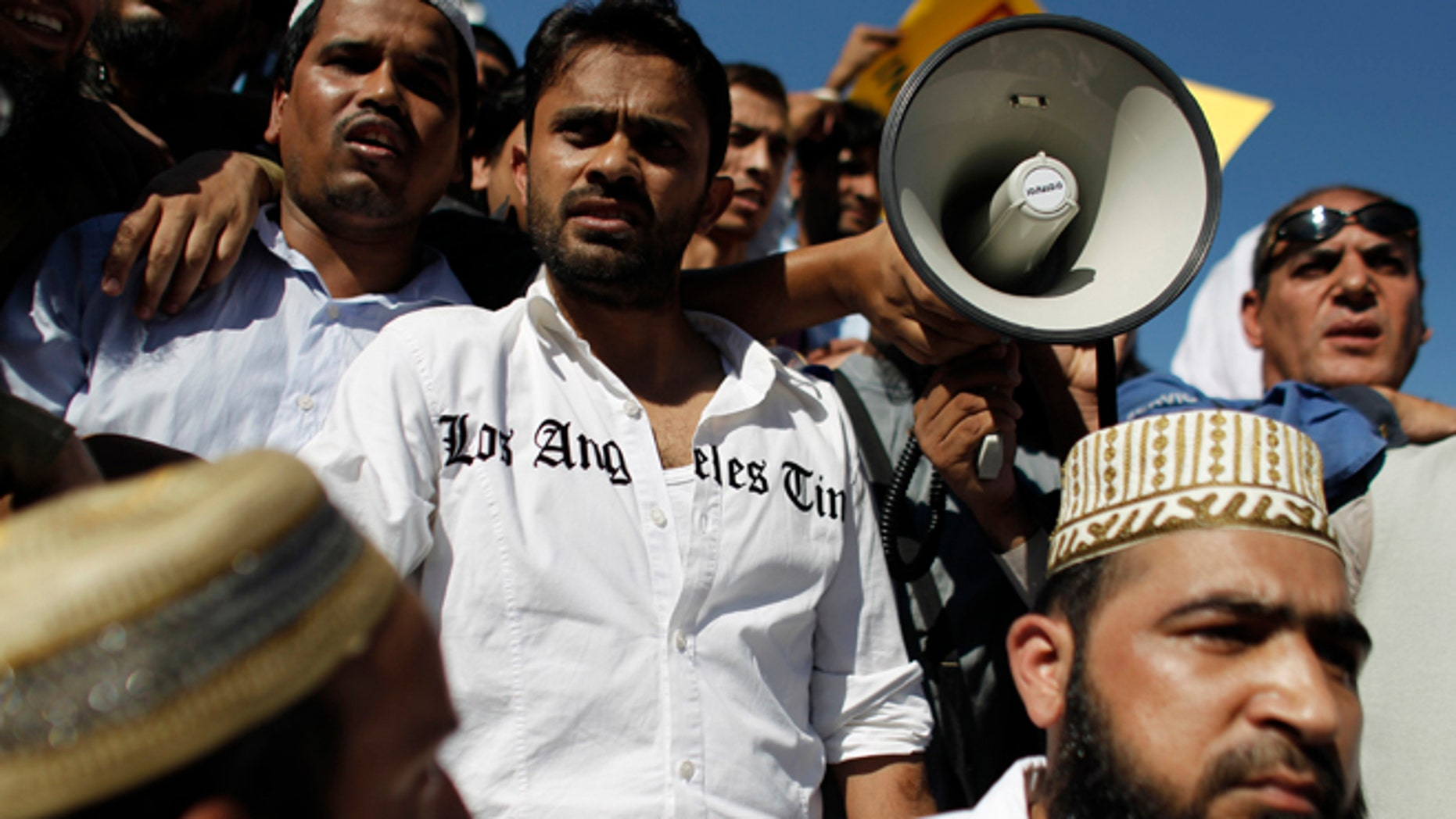 Sun. 23, 2012: A man wears a shirt bearing the name of an American newspaper, as Muslim protest against a film produced in the U.S. that they say insults the Prophet Muhammad, in Athens.