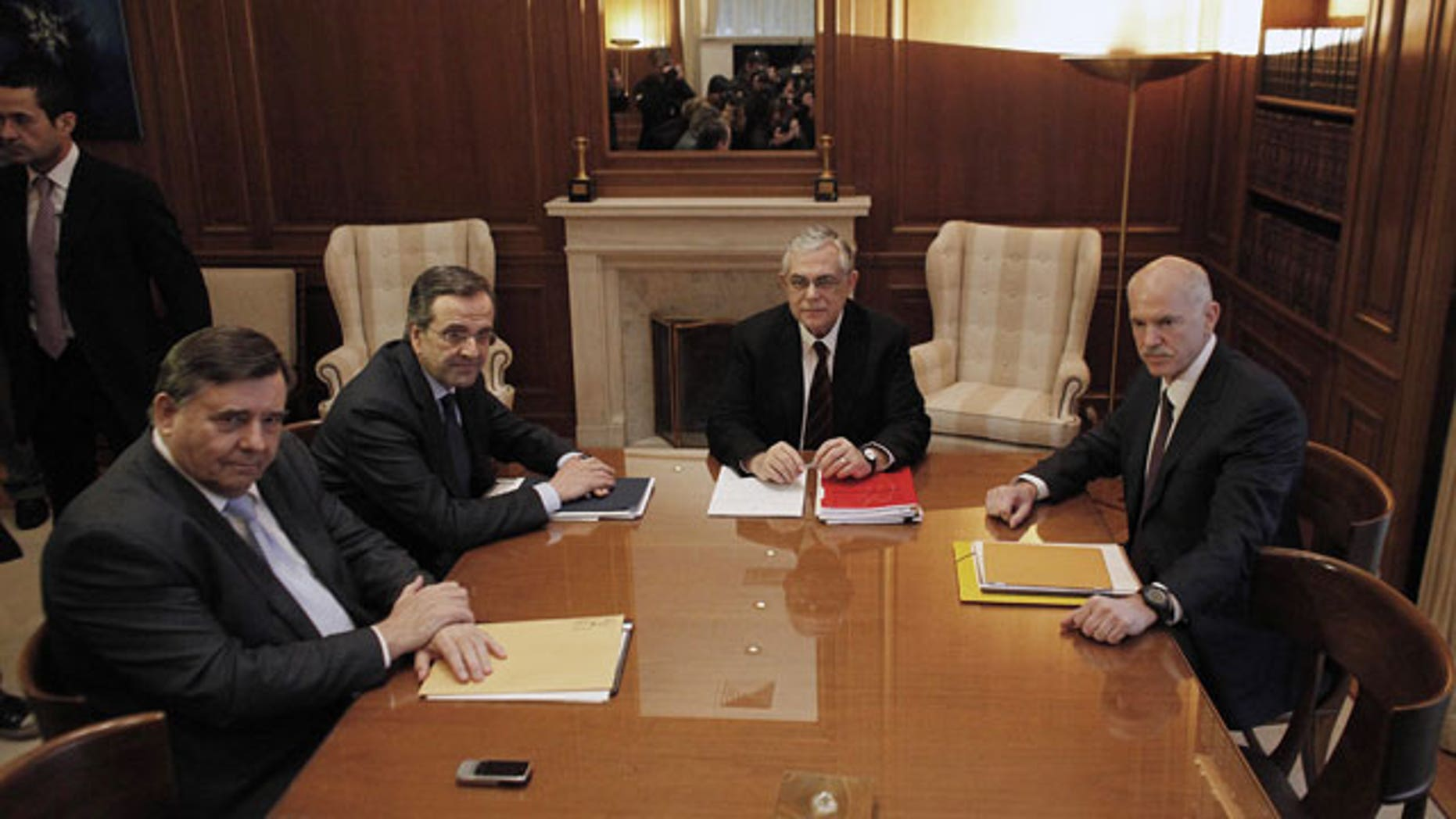 Feb. 4, 2012: The leaders of the three parties backing Greece's coalition government, George Papandreou, right, Giorgos Karatzaferis, left, and Antonis Samaras, 2nd left, meet with Prime Minister Lucas Papademos, 2nd from left, in Athens.