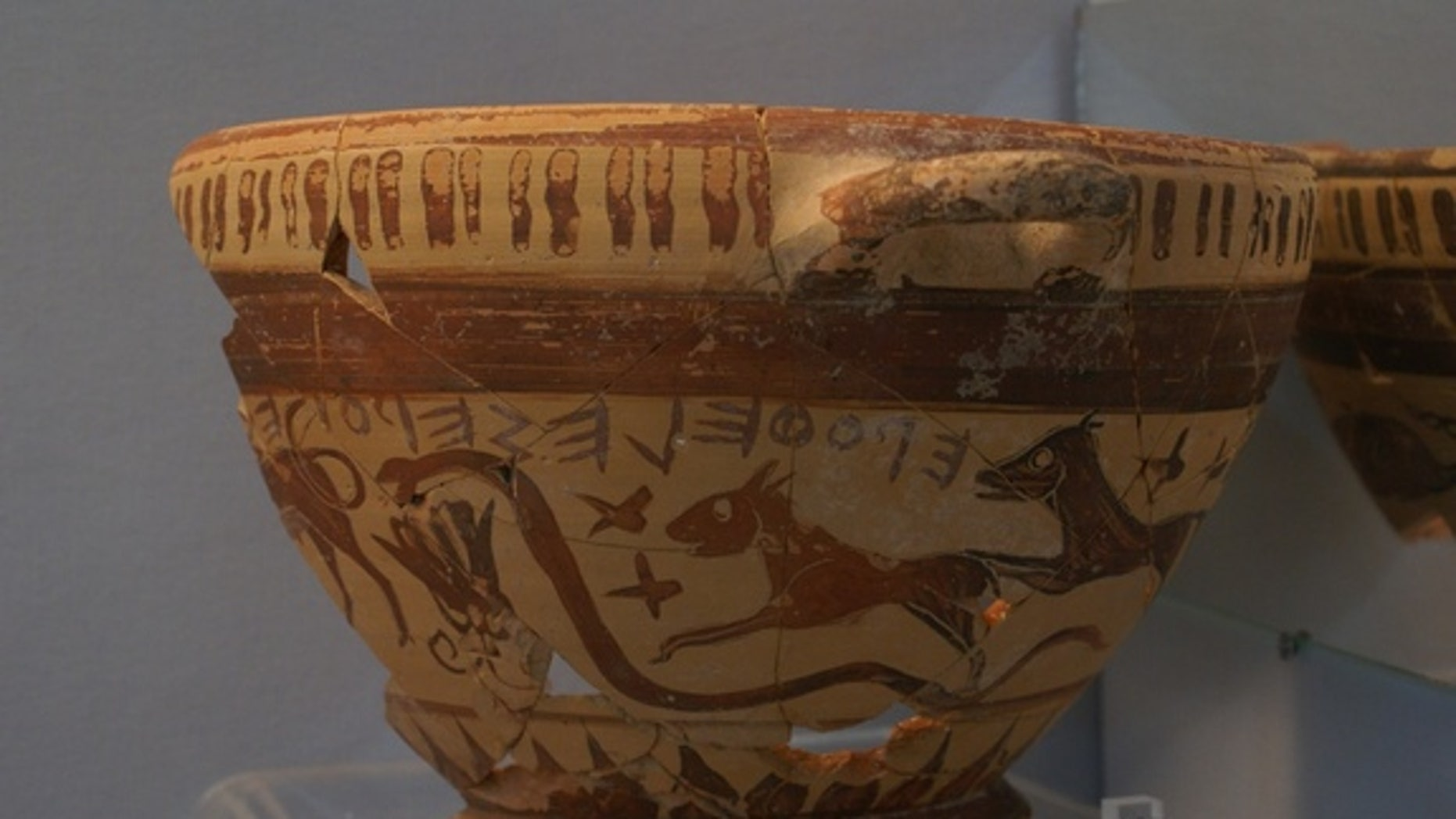 A two-handled wine cup may hold some of the earliest Greek depictions of the constellations. Here, a bull, snake, rabbit/small dog and large dog decorations.