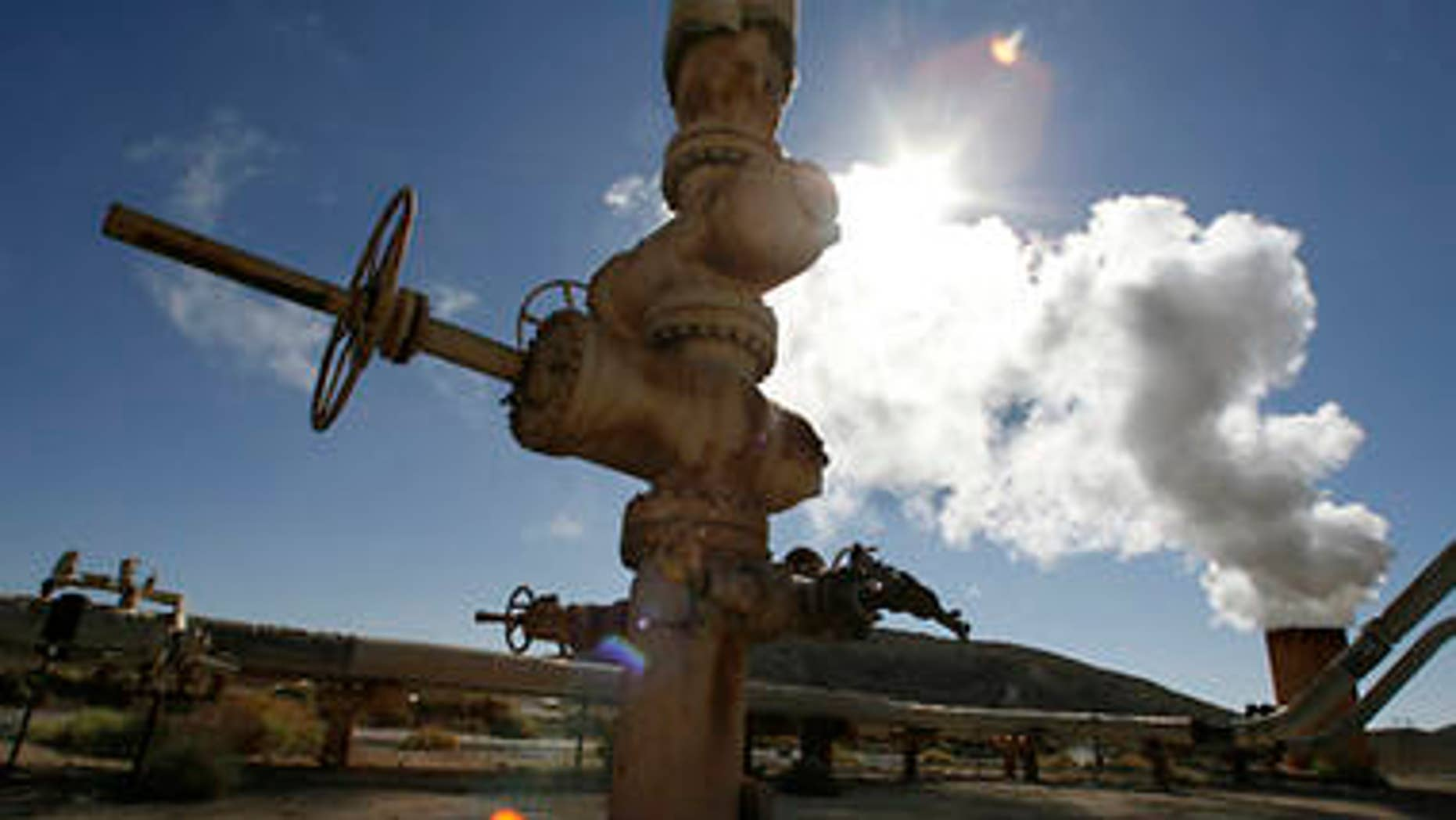 Steam rises during a test from a well at the Coso geothermal field at the China Lake Naval Air Weapons Station in China Lake, California in this July 31, 2008 file photo. California set detailed goals to cut greenhouse gases and address global warming on December 11, 2008 in the face of strong criticism that an economic analysis buttressing the plan was hopelessly optimistic.     REUTERS/Fred Prouser/Files        (UNITED STATES)