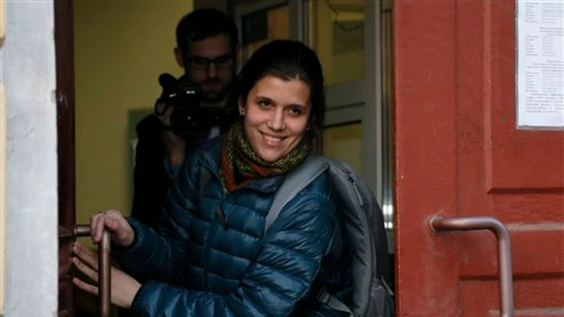 Camila Speziale exits the Federal Migration Service in St. Petersburg, Russia, on Dec. 25, 2013.