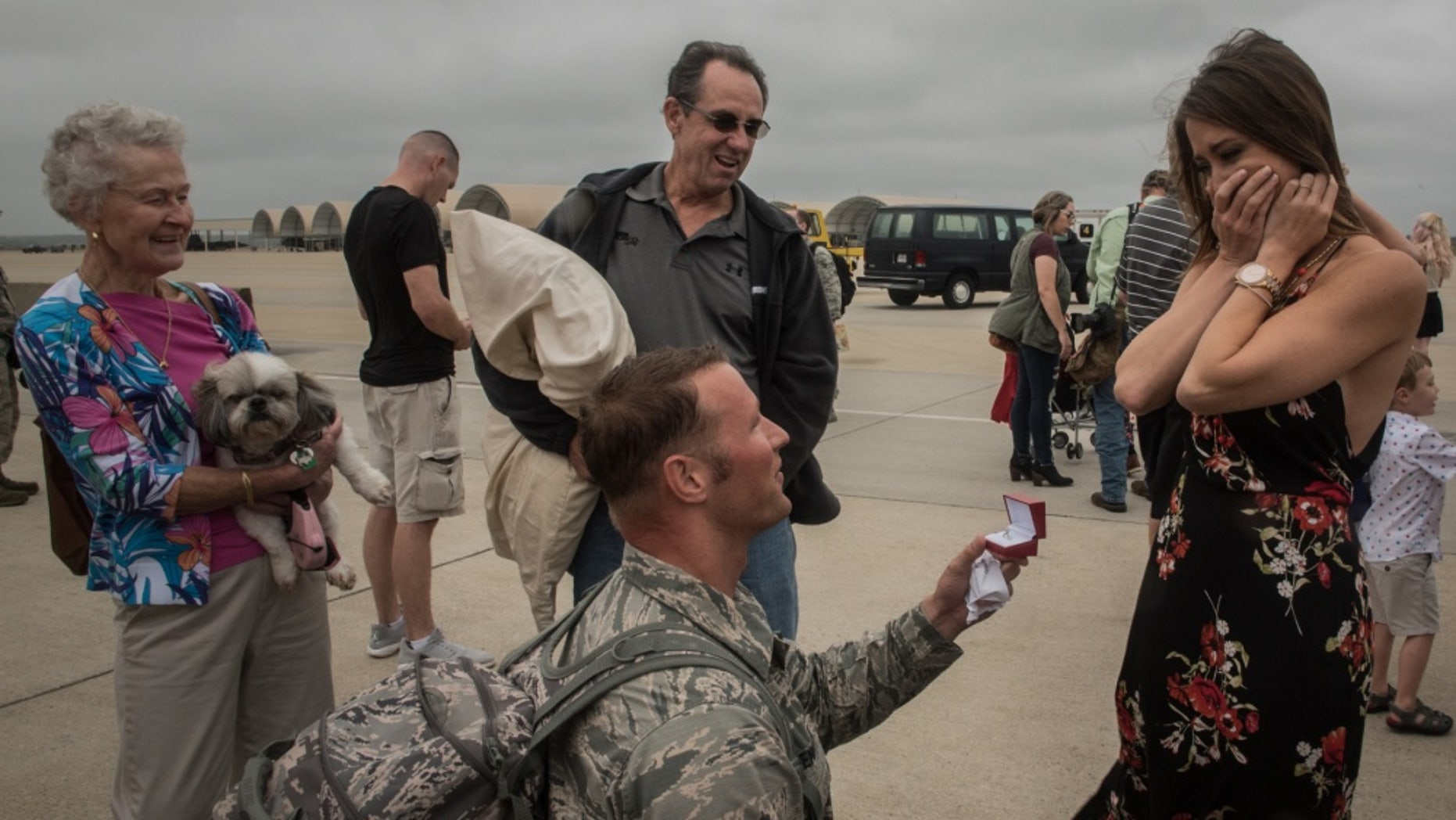 Virginia Air National Guard Staff Sgt. Jeff Greenquist (left) returned from a six-month deployment to the Middle East and asked girlfriend, Ashley Branham, to marry him. (U.S. Air Force photo by Staff Sgt. Carlin Leslie)