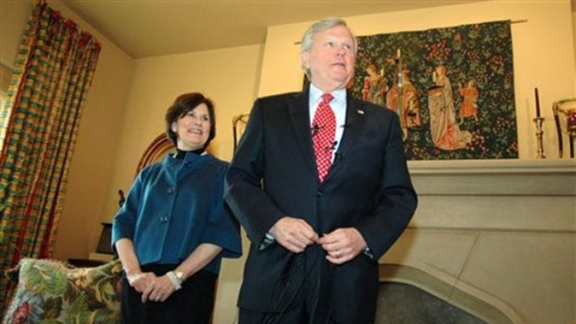 Rep. Parker Griffith, accompanied by his wife Virginia, prepares to talk to the media at his home in Huntsville, Ala. , Dec. 22. (AP Photo)