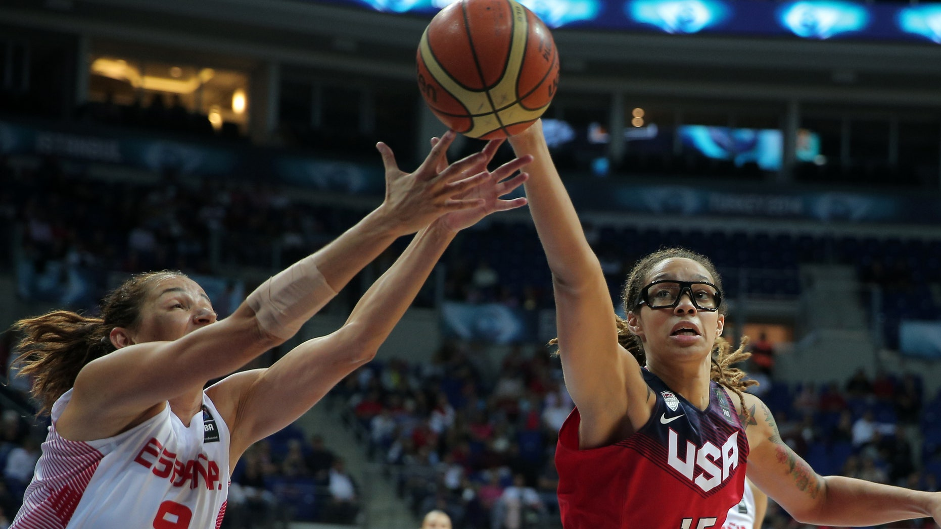 Oct. 5, 2014: Laia Palau, left, of Spain, and Brittney Griner of the US, fight for the ball during the Basketball World Championship for Women's final