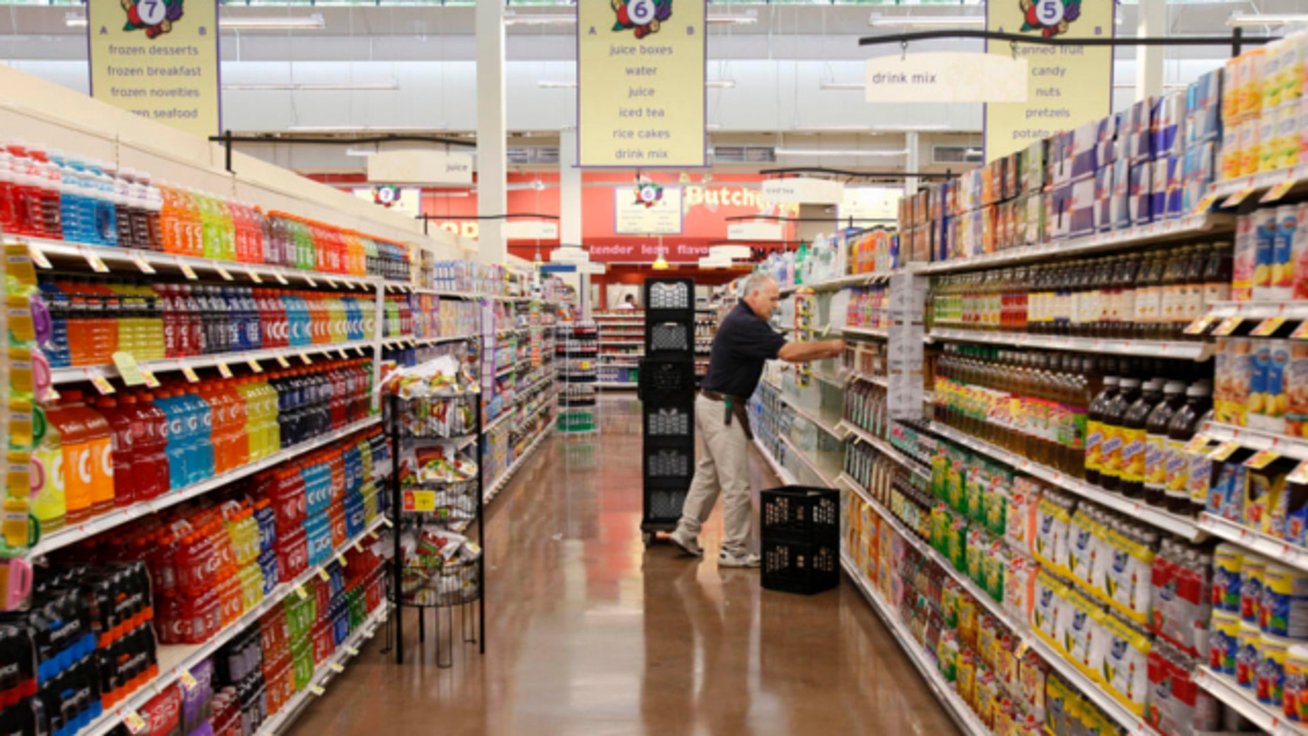 July 22, 2009: A worker stocks an aisle at Hannaford supermarket in Augusta, Ga.