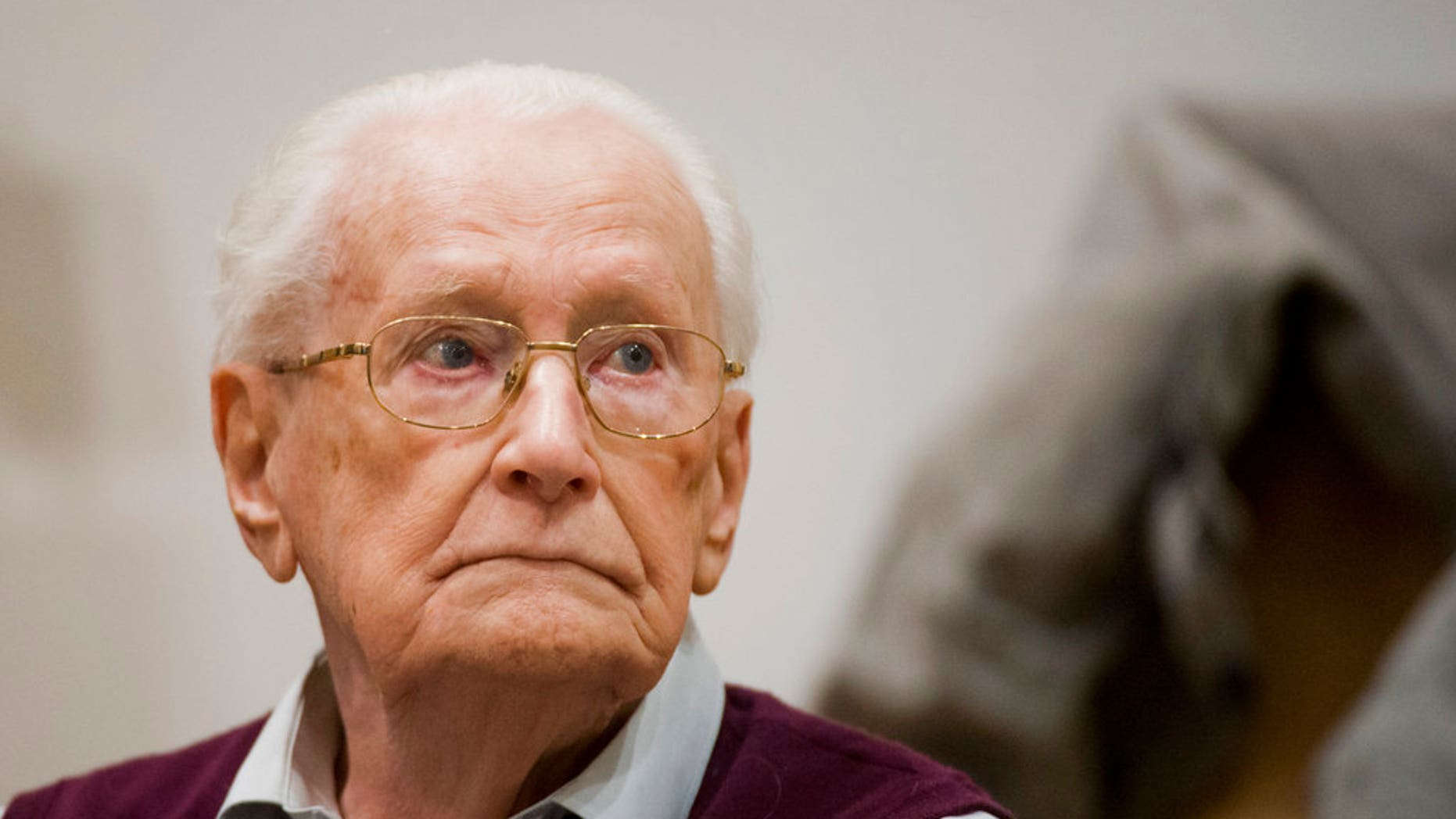 Former SS guard Oskar Groening waits for the start his trial in a courtroom in Lueneburg, northern Germany.