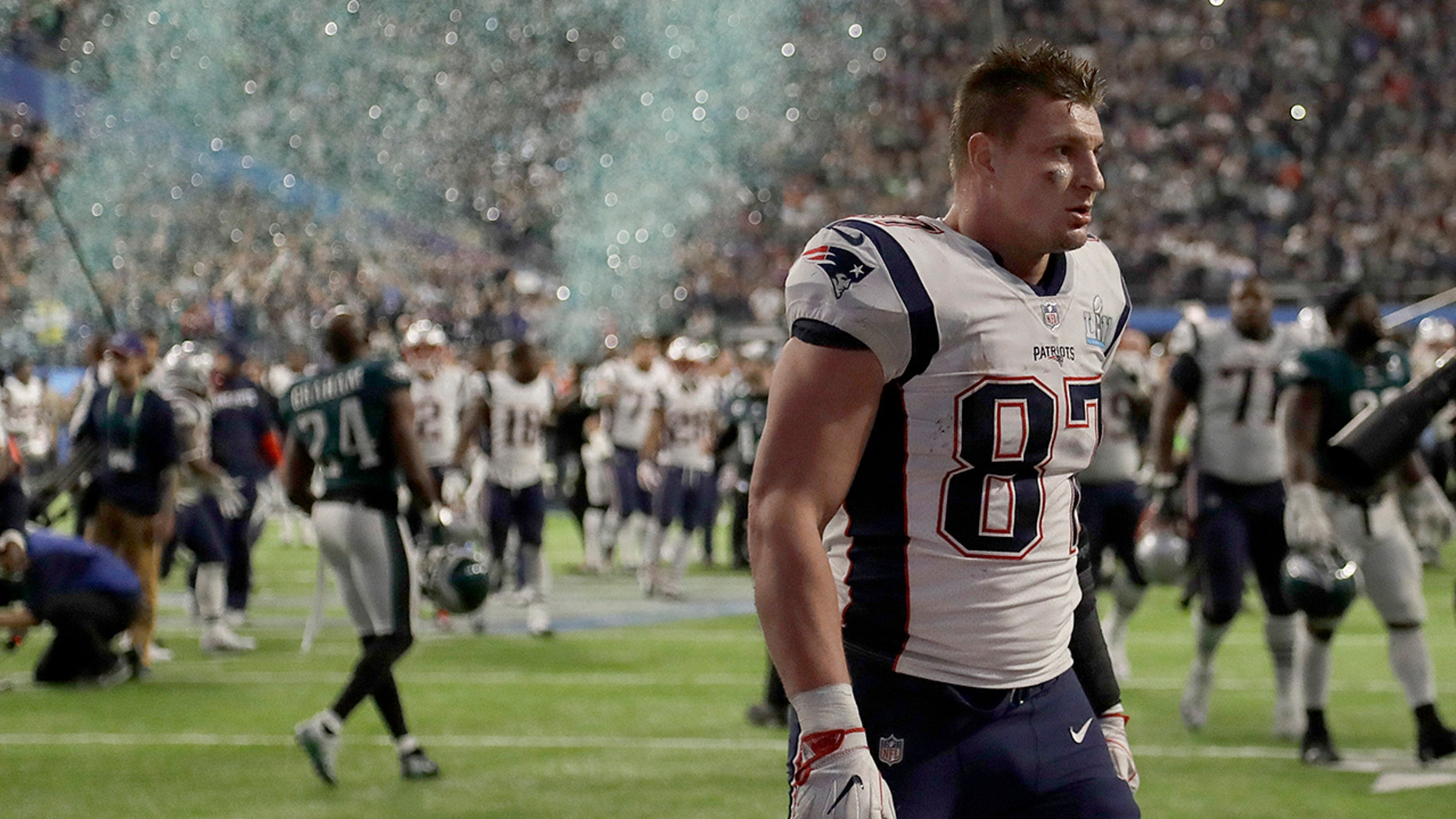 New England Patriots star Rob Gronkowski walks off the field after his team's Super Bowl LII loss to the Philadelphia Eagles, Feb. 4, 2018, in Minneapolis.