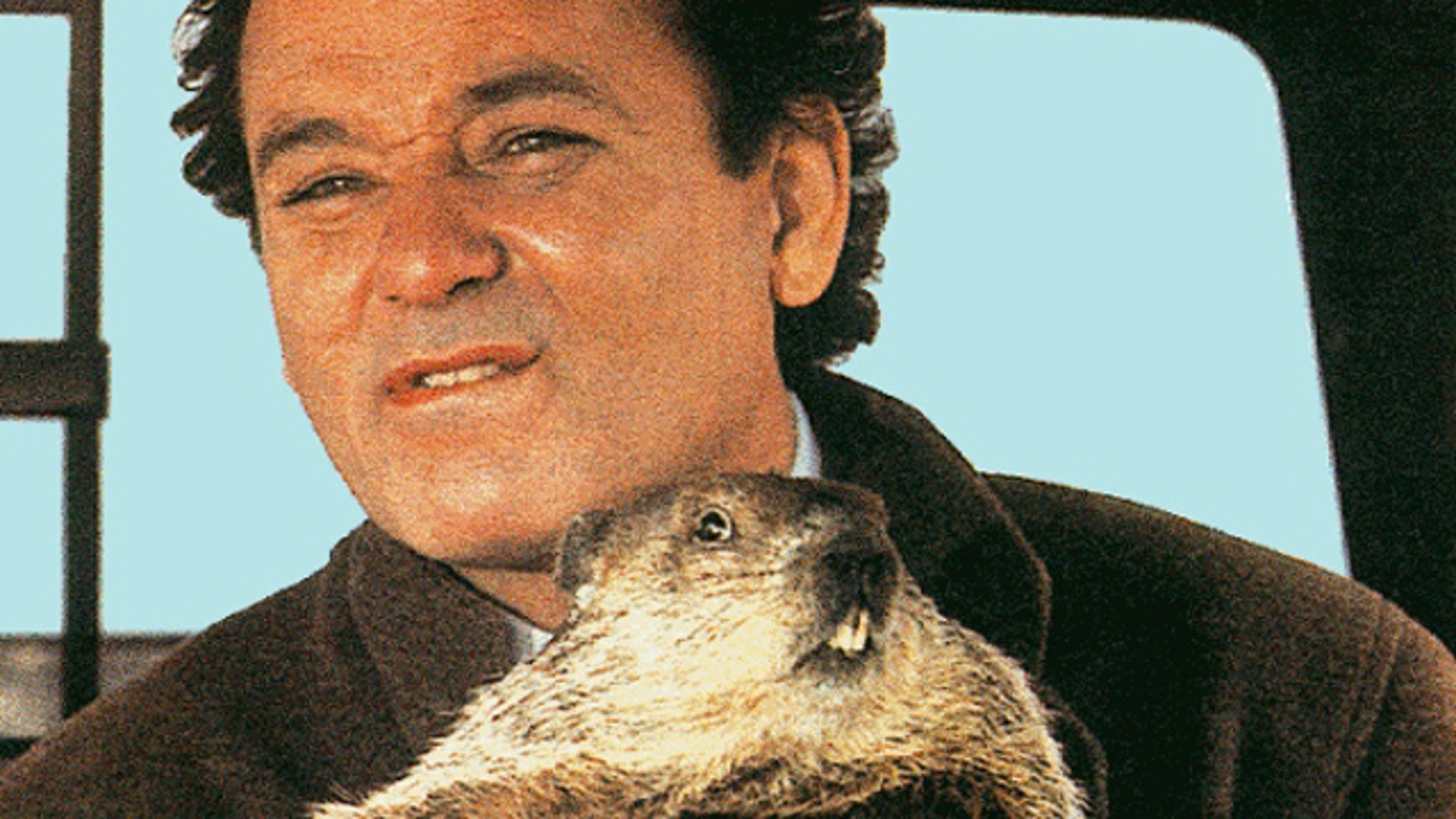 "Bill Murray and a friend drive a truck in a scence from the movie ""Groundhog Day."""