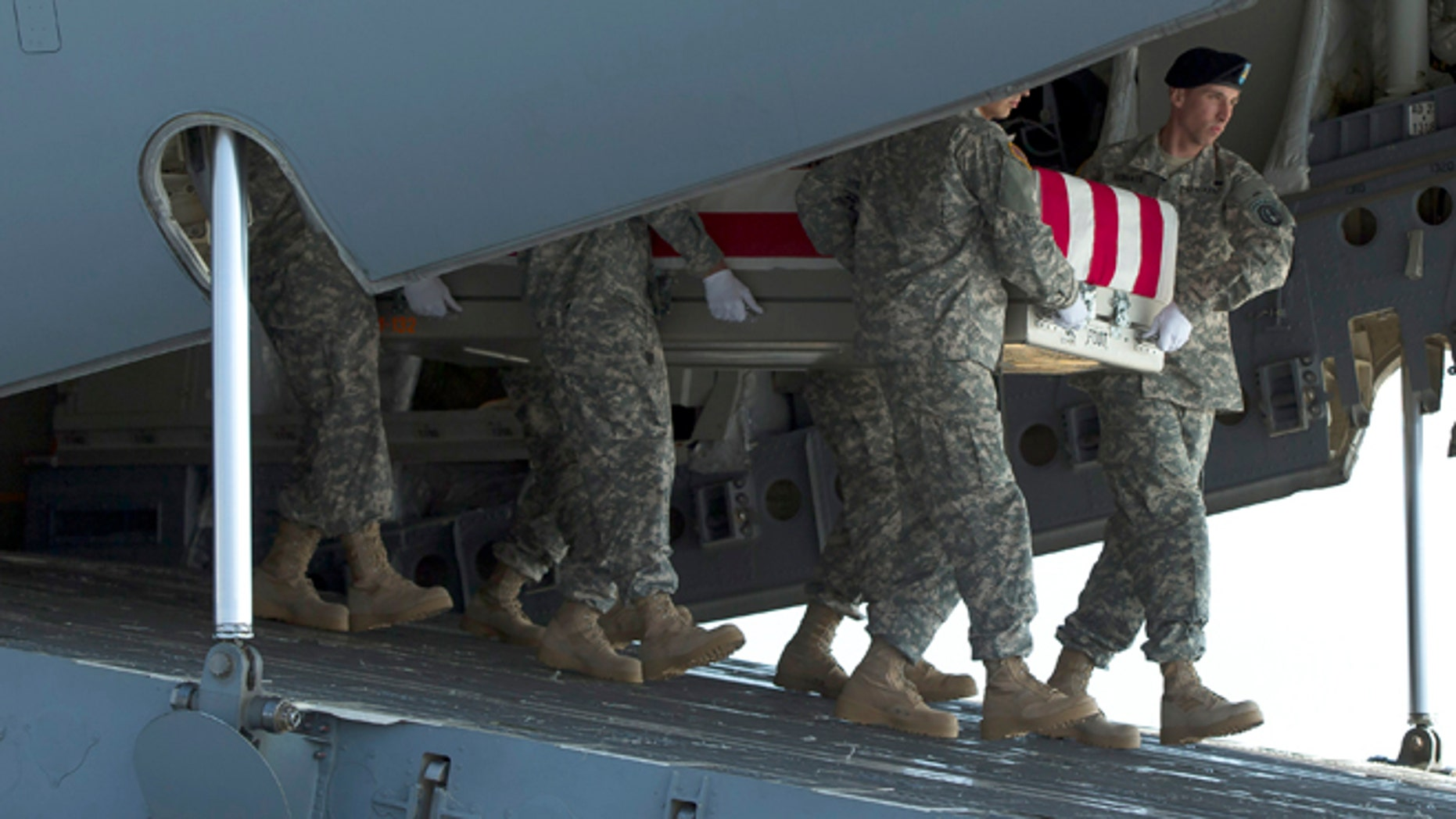 An Army carry team transfers the remains of Army Maj. Gen. Harold Greene, Thursday, Aug. 7, 2014, at Dover Air Force Base, Del.The C-17 cargo plane carrying the body of Harold Greene landed Thursday morning at Dover, home to the nation's largest military mortuary. Greene is the highest-ranked U.S. officer to be killed in combat since 1970 during the Vietnam War. Greene, a 34-year U.S. Army veteran, also is the highest-ranked American officer killed in combat in the wars in Afghanistan and Iraq.  (AP Photo/Evan Vucci)