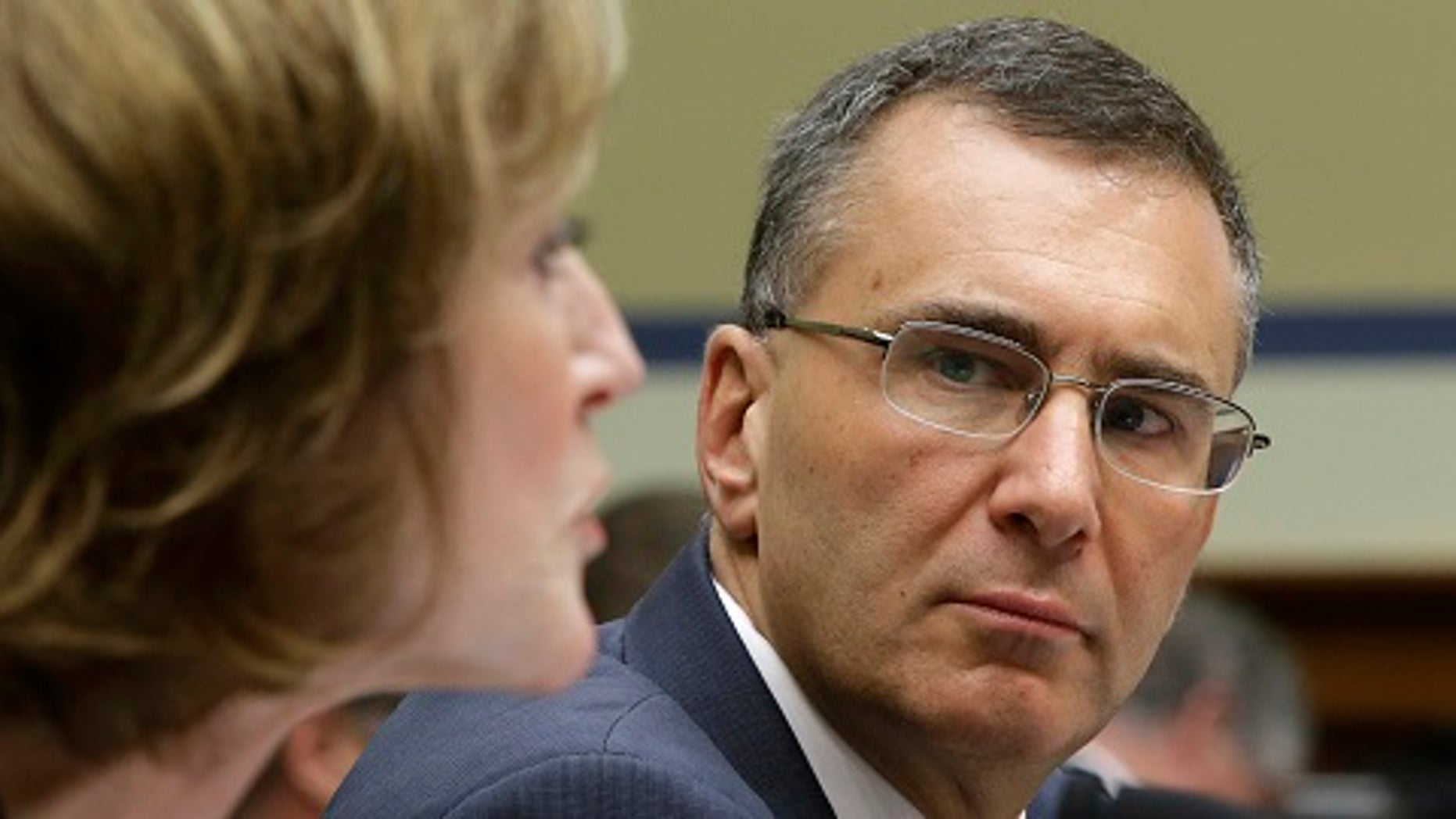 "Obamacare consultant Jonathan Gruber (R) listens to Centers for Medicare and Medicaid Services Administrator Marilyn Tavenner during testimony before a U.S. House Oversight and Government Reform hearing on ""Examining Obama Transparency Failures"" in Washington December 9, 2014. Gruber apologized on Tuesday for his recent remarks about ""the stupidity of the American voter,"" telling a congressional committee he did not think President Barack Obama's signature healthcare law was passed in a deceptive manner. REUTERS/Gary Cameron (UNITED STATES - Tags: POLITICS HEALTH) - RTR4HBJA"