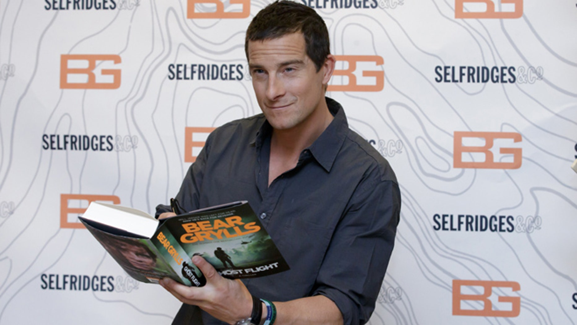 June 4, 2015: British writer and TV presenter Bear Grylls poses for photographers before signing copies of his new book at Selfridges in London.