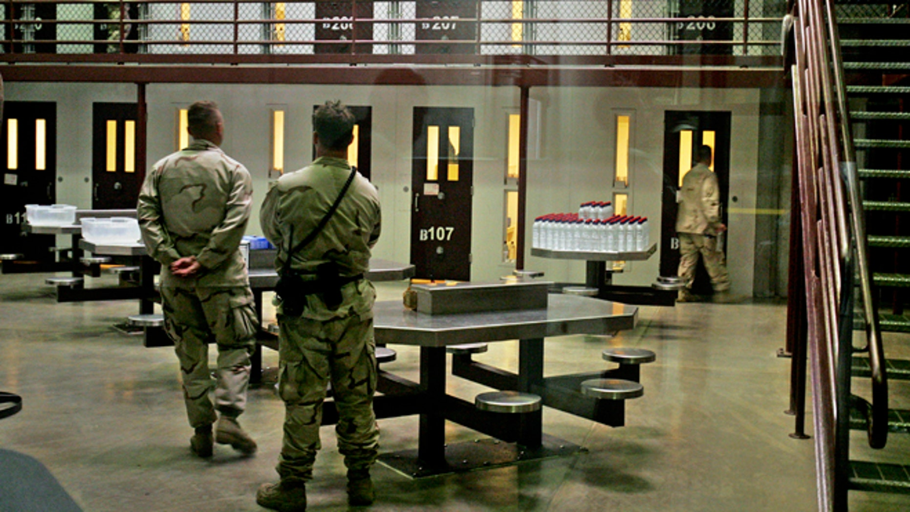 In this  Oct. 9, 2007 file photo, Guantanamo guards keep watch over a cell block with detainees in Camp 6 maximum-security facility, at Guantanamo Bay U.S. Naval Base, Cuba.