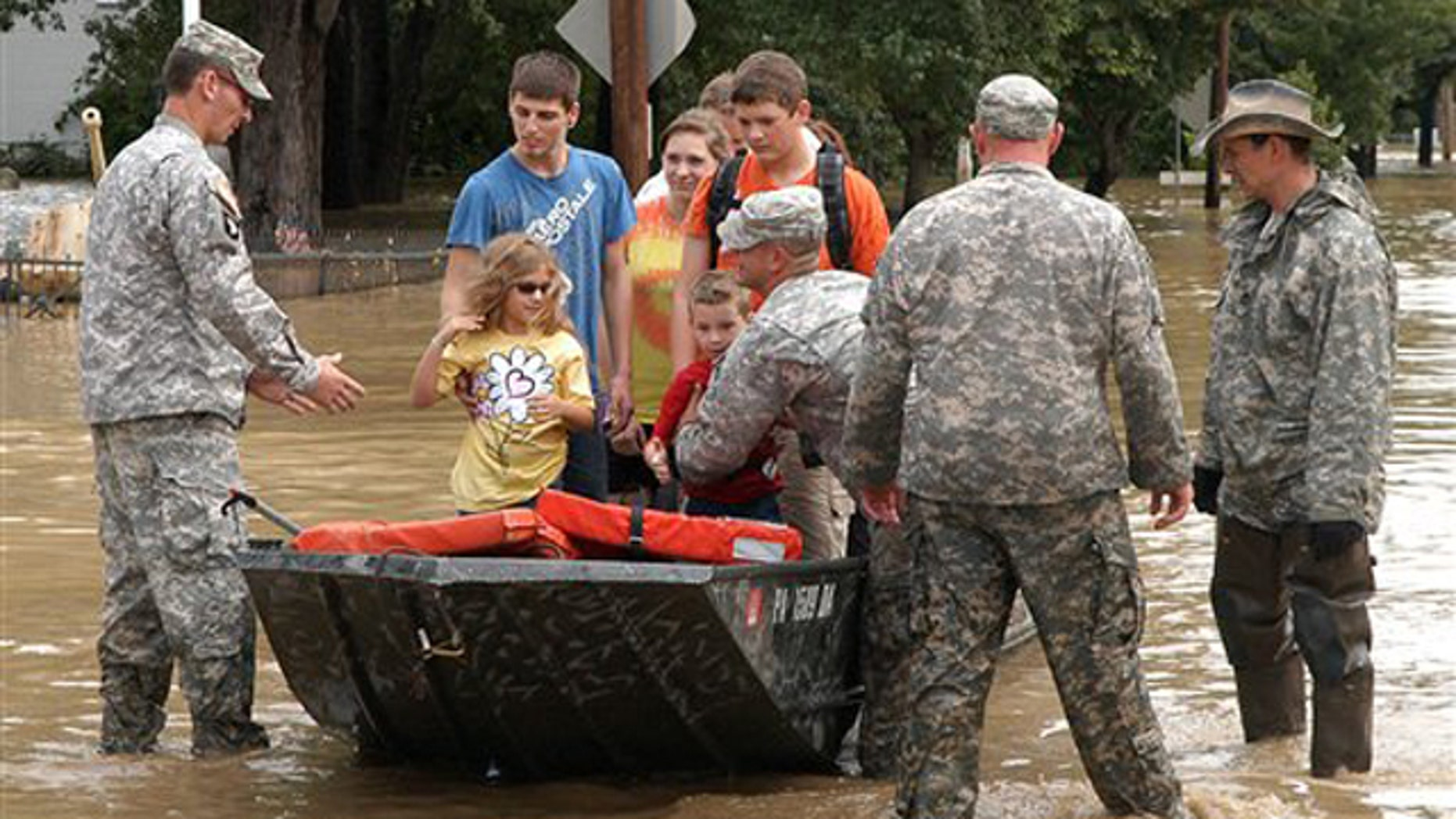 The Army National Guard is shown rescuing residents from their home Sept. 9 in West Pittston, Pa., amid high floodwaters.