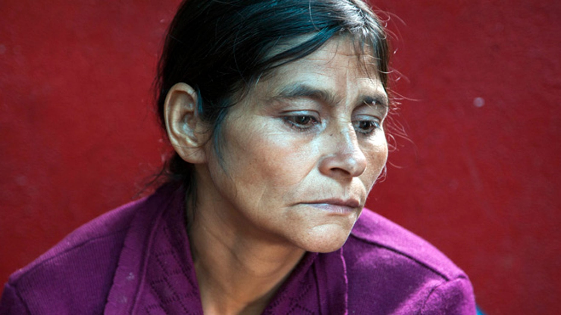 July 1, 2014: Cipriana Juarez Diaz, mother of Gilberto Francisco Ramos Juarez, a Guatemalan boy whose decomposed body was found in the Rio Grande Valley of South Texas, listens to her husband talk during an interview at their home in San Jose Las Flores, in the northern Cuchumatanes mountains of Guatemala.