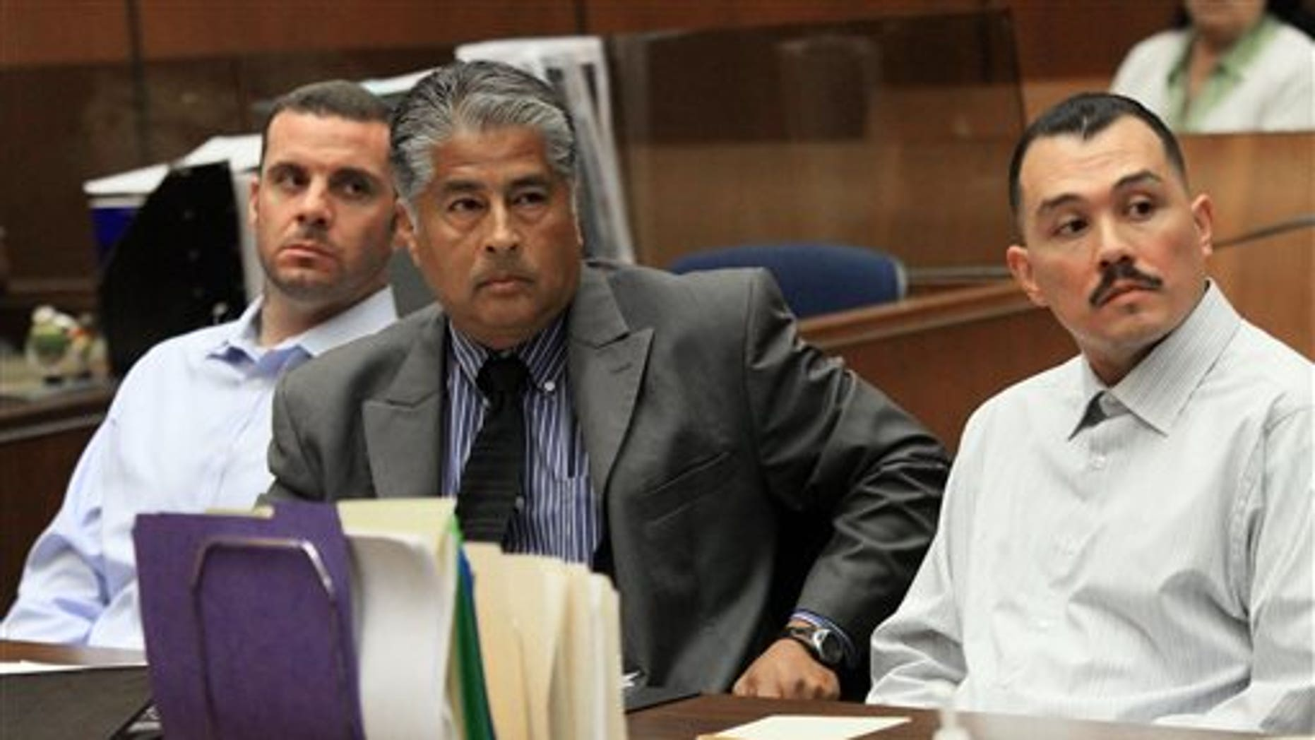 FILE - In this May 31, 2012 file photo, Marvin Norwood , left, with attorney Victor Escobedo, center, and co-defendant Louie Sanchez appear during a preliminary hearing held in Los Angeles Superior court. The two men have pleaded guilty on Thursday, Feb. 20, 2014 in Los Angeles to a 2011 beating at Dodger Stadium that left San Francisco Giants fan Bryan Stow brain damaged and disabled. (AP Photo/Los Angeles Times, Irfan Khan, Pool, File)