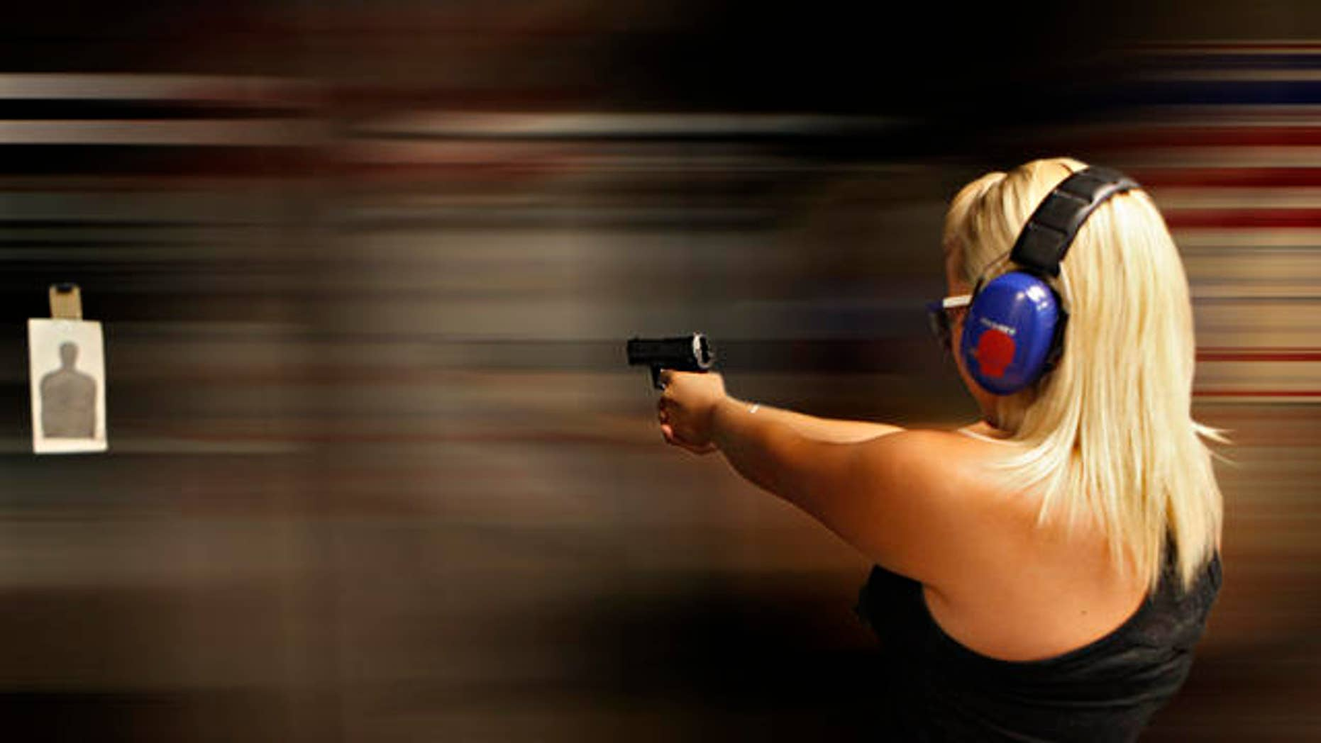 Sarah Bard, of Gilbert, shoots at Caswells Shooting Range, Tuesday, April 6, 2010 in Mesa, Ariz. in preparation for her upcoming concealed weapons test. Gov. Jan Brewer has signed into law two bills supported by gun-rights activists. One of the bills signed Monday would broaden the state's current restrictions on local governments' ability to regulate or tax guns and ammunition. (AP Photo/Matt York)
