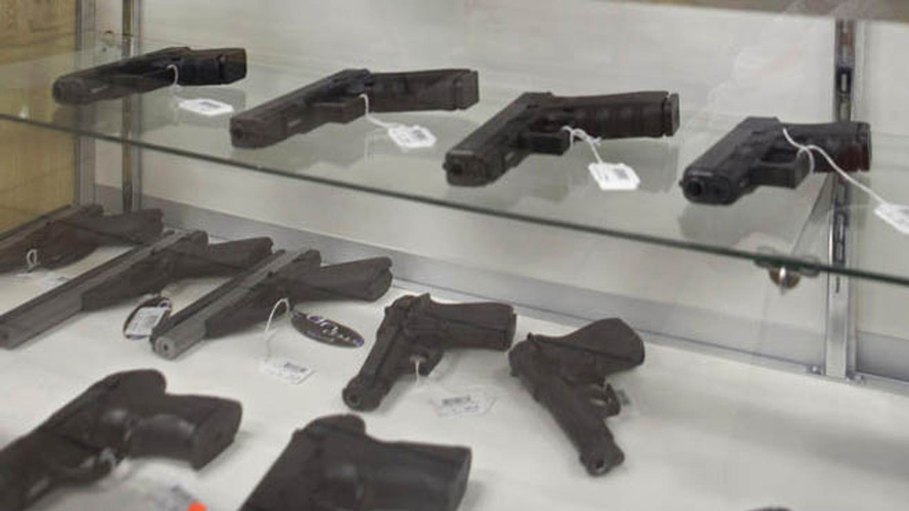 Jan. 16, 2013: Firearms are shown for sale at a store in Middlefield, Ohio.
