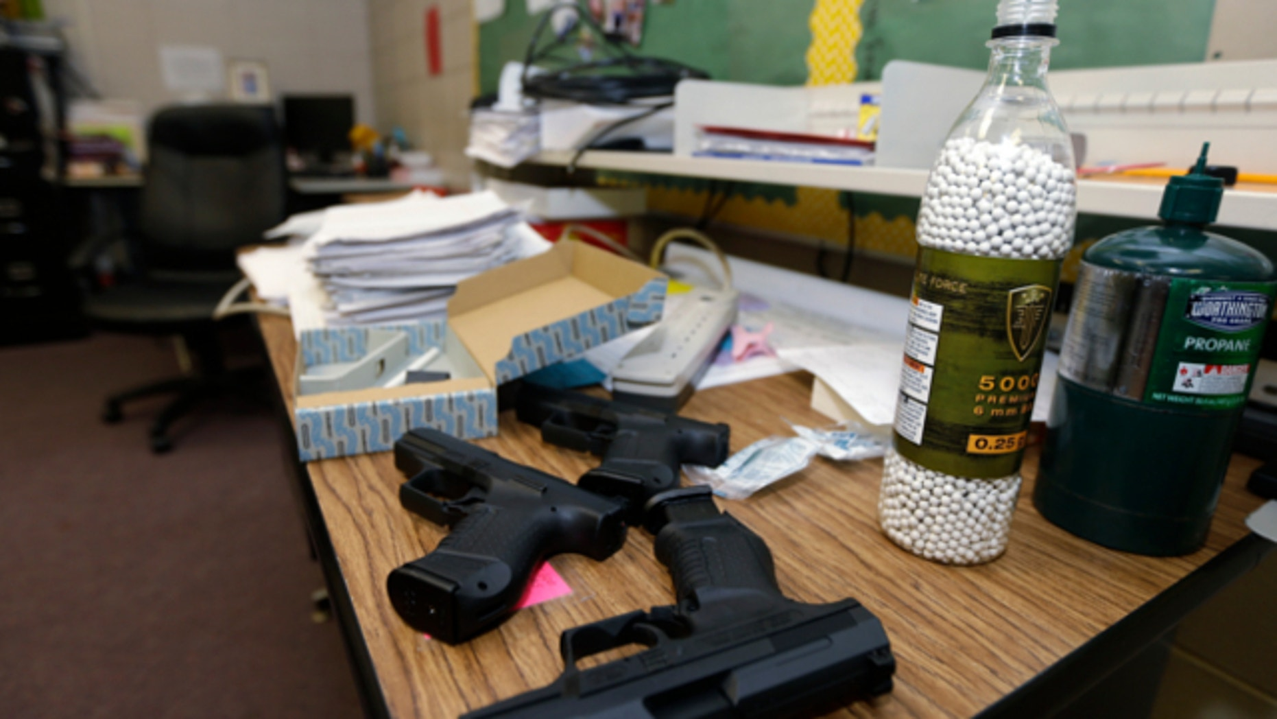 July 11, 2013: Practice air-powered handguns sit on a teacher's desk in a classroom at Clarksville High School in Clarksville, Ark.