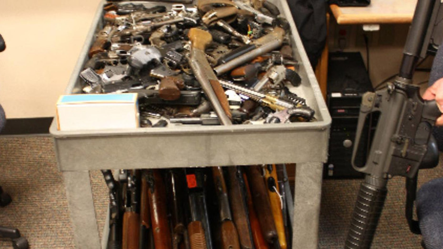 The program took in more than 100 guns, but firearms enthusiasts claimed they made out even better. [Courtesy: Newport Police Department]