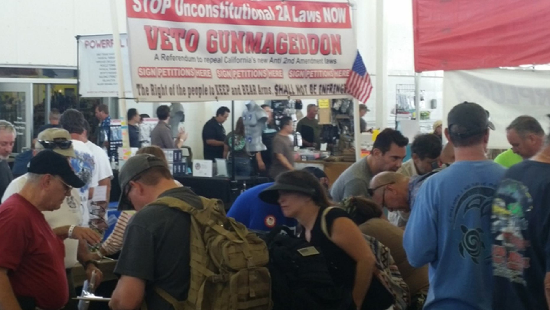 "The group dubbed ""Veto Gunmageddon"" made its presence known at a gun show in Costa Mesa, Calif., and at others around the state."
