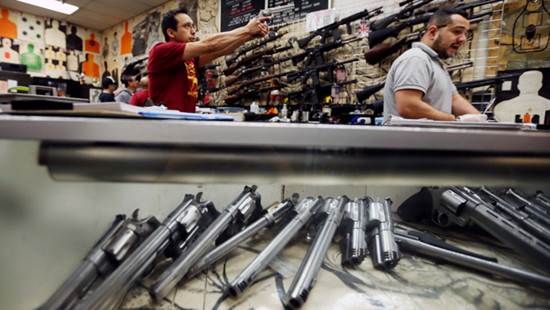 Jan. 23, 2013: Employees demonstrate gun safety to clients at the Los Angeles gun club in Los Angeles.