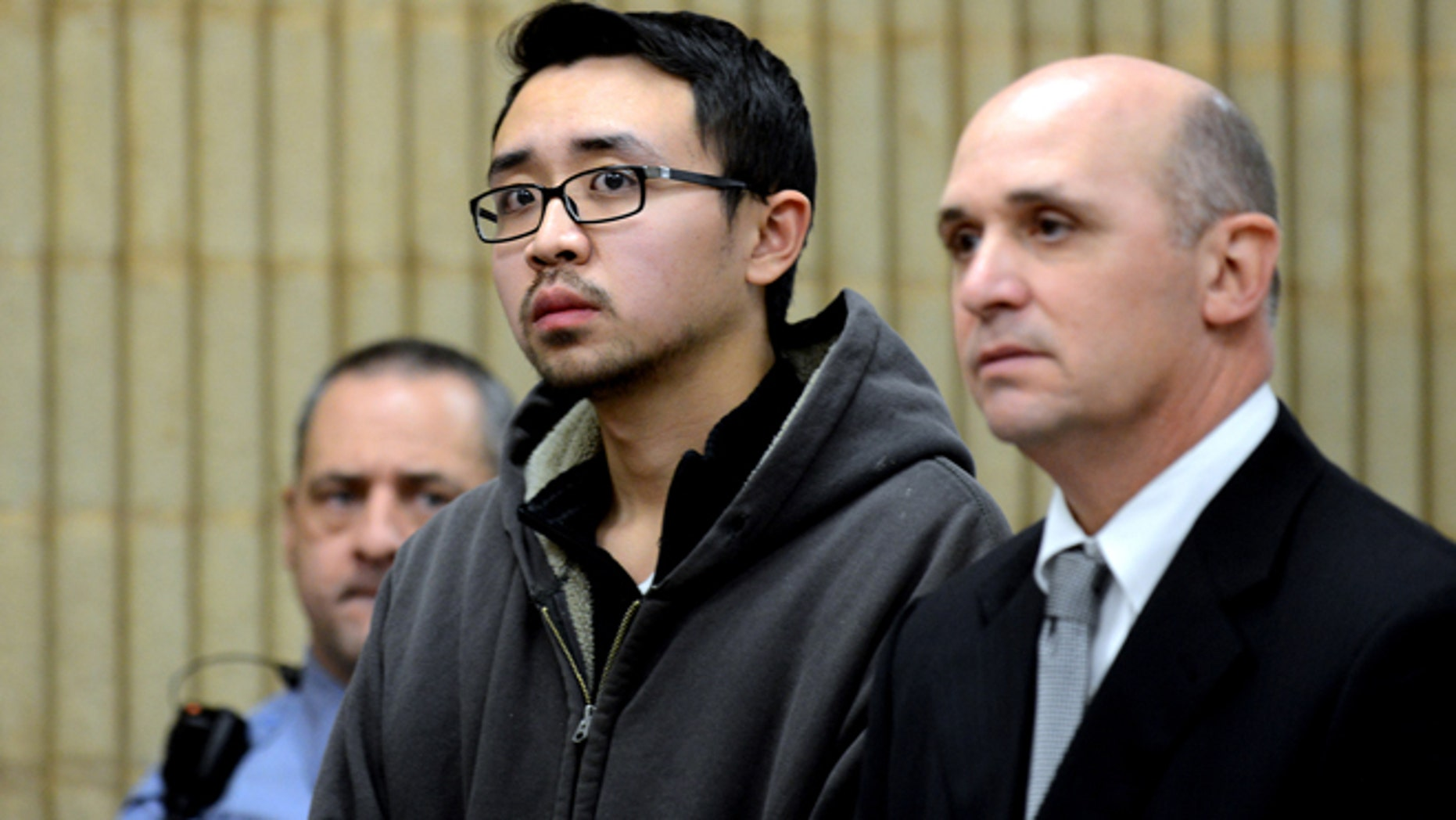 Dec. 4, 2013: University of New Haven student William Dong, 22, of Fairfield, Conn., with assistant public defender Kevin Williams, right, appears during his arraignment.