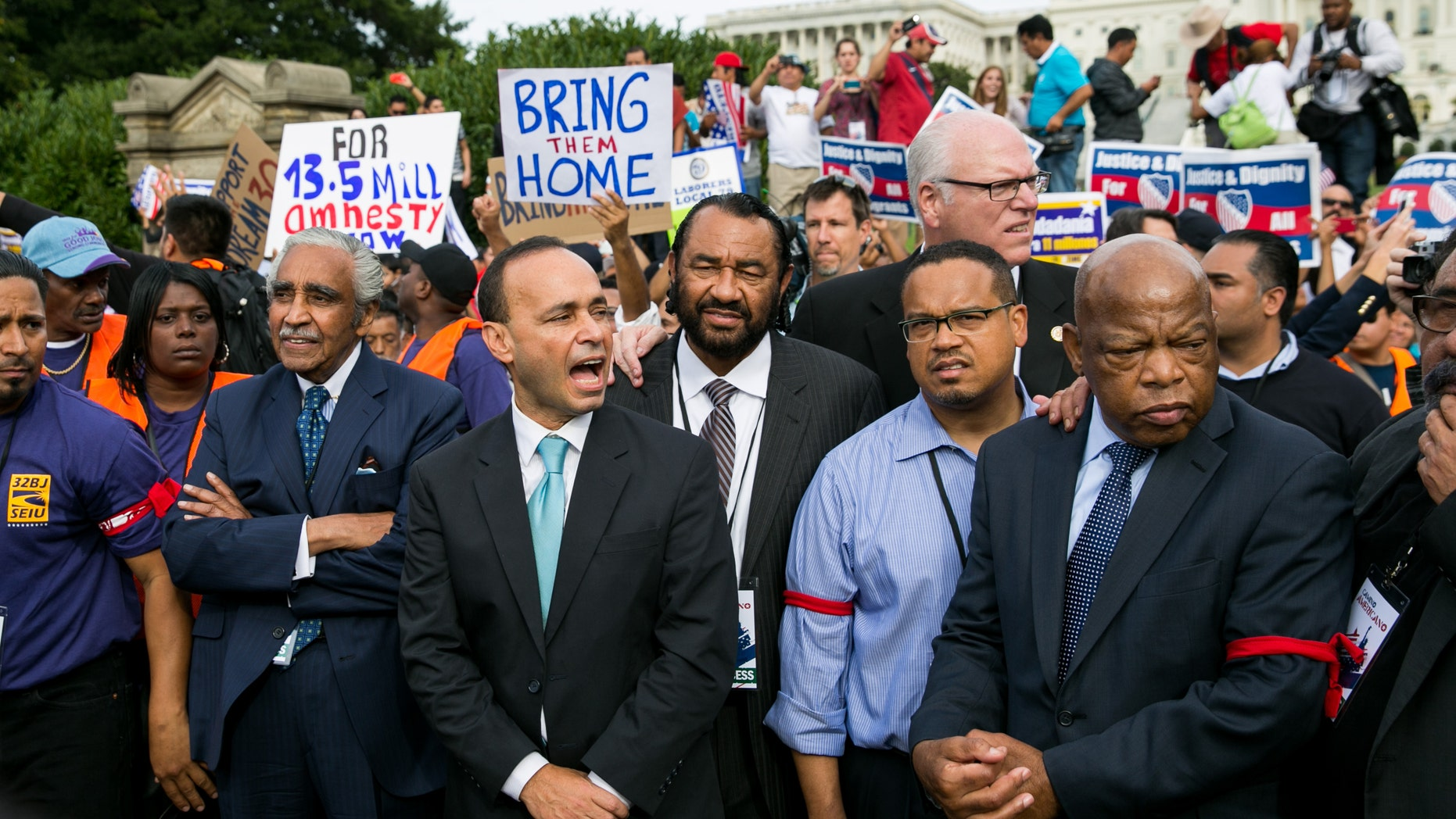 (L-R) Rep. Charles Rangel (D-NY), Rep. Luis Gutierrez (D-IL), Rep. Al Green (D-TX), Rep. Keith Ellison (D-MN) and Rep. John Lewis (D-GA) stand with immigration reform supporters in front of the U.S. Capitol.