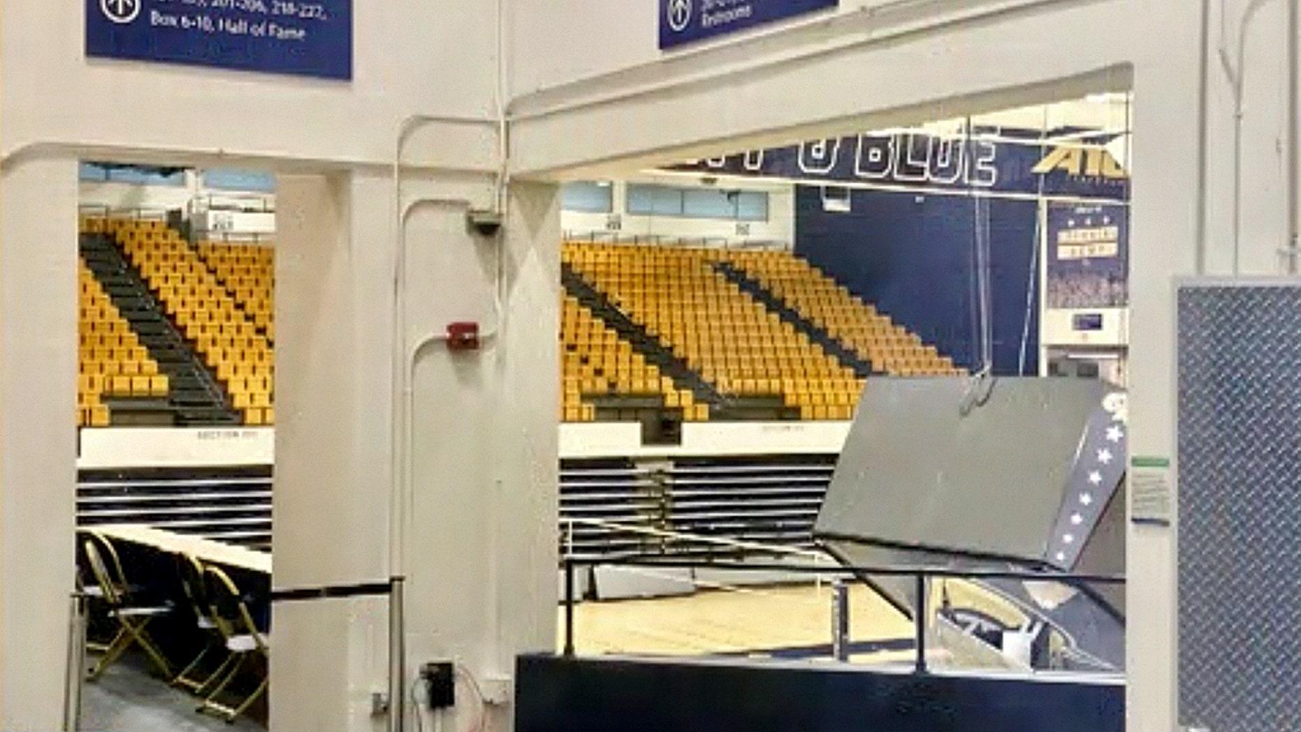 The scoreboard hanging above a George Washington University arena came crashing down on Tuesday.